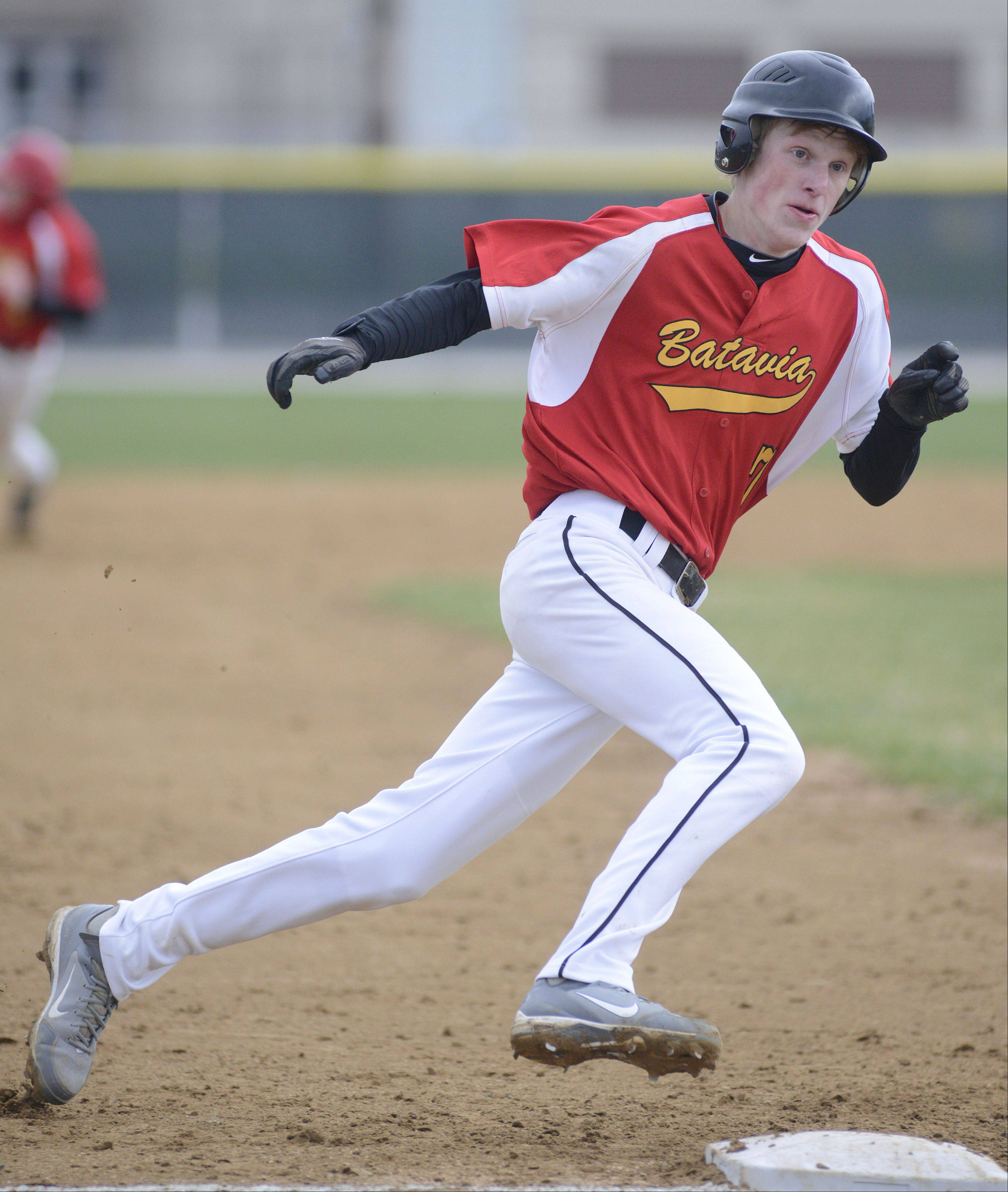 Batavia's Andrew Seigler rounds third base on his way to home plate in the second inning on Friday, April 12.