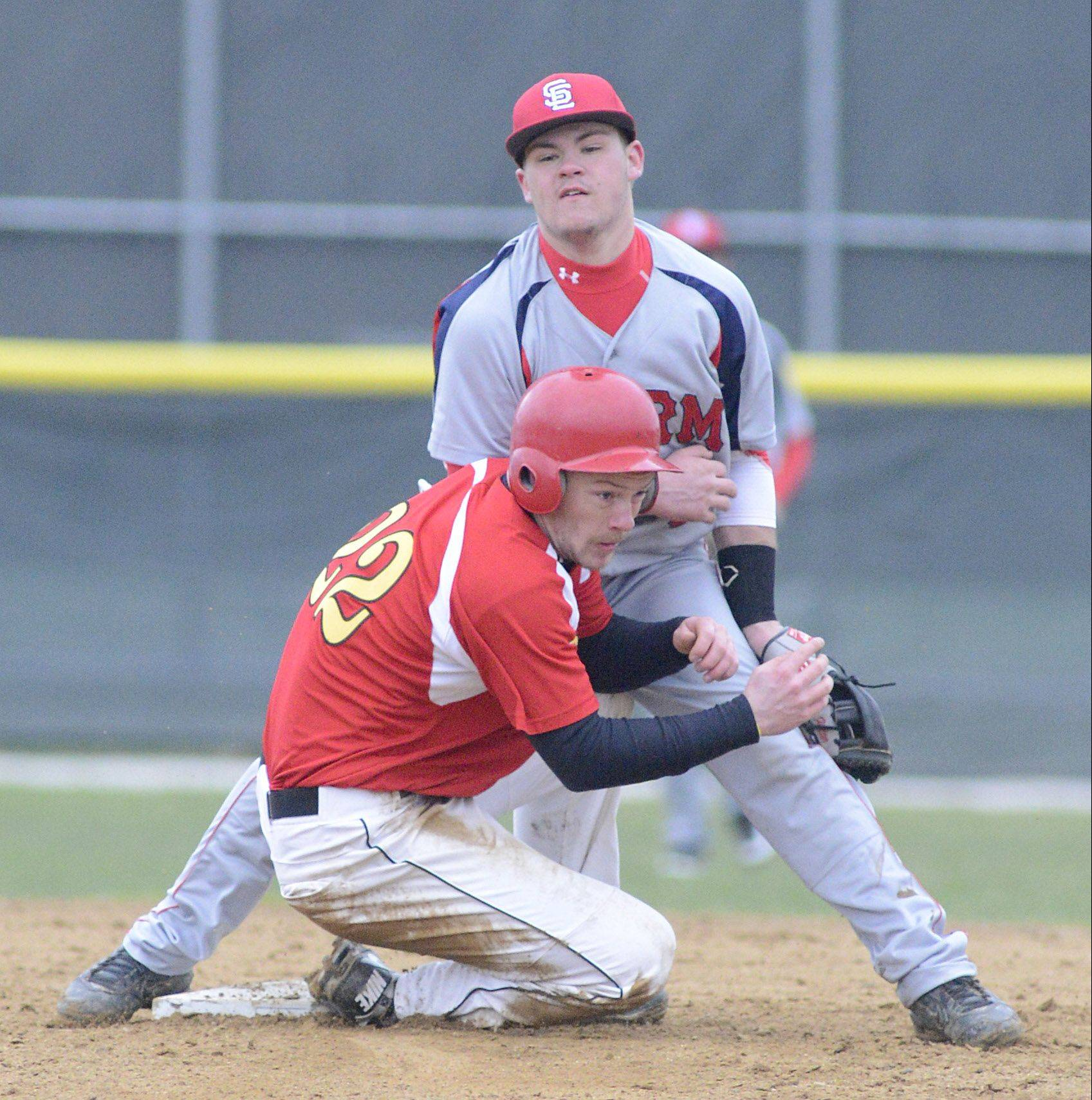 Third-year starter Robbie Bowman breaks up a double play for Batavia against South Elgin's Riley Halter last Friday.