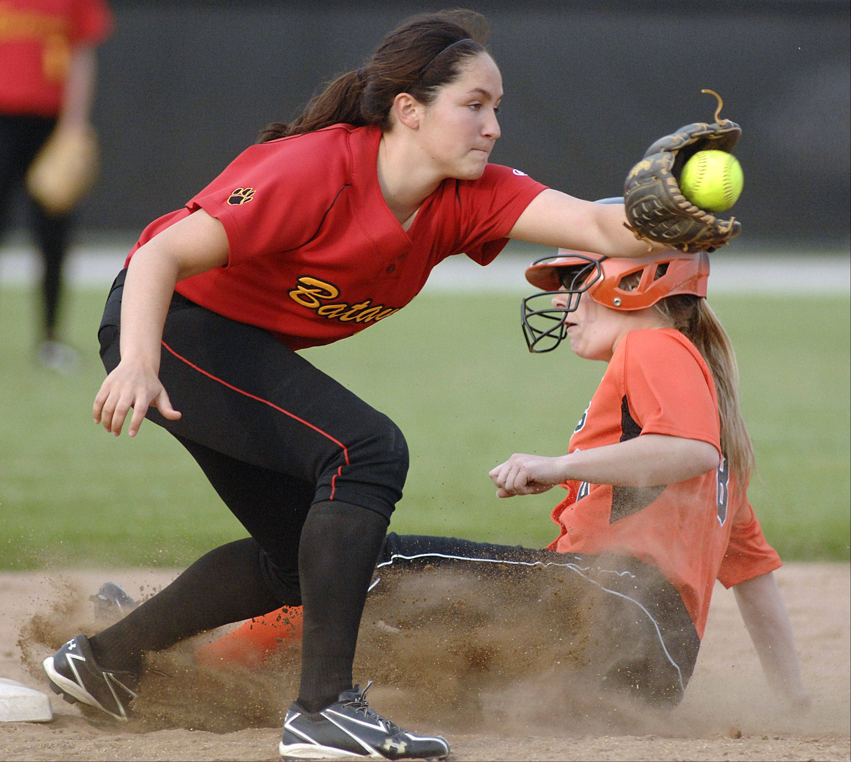 St. Charles East's Sarah Collalti is safe on second base from Batavia's Sami Villarreal in the sixth inning on Wednesday, April 25.