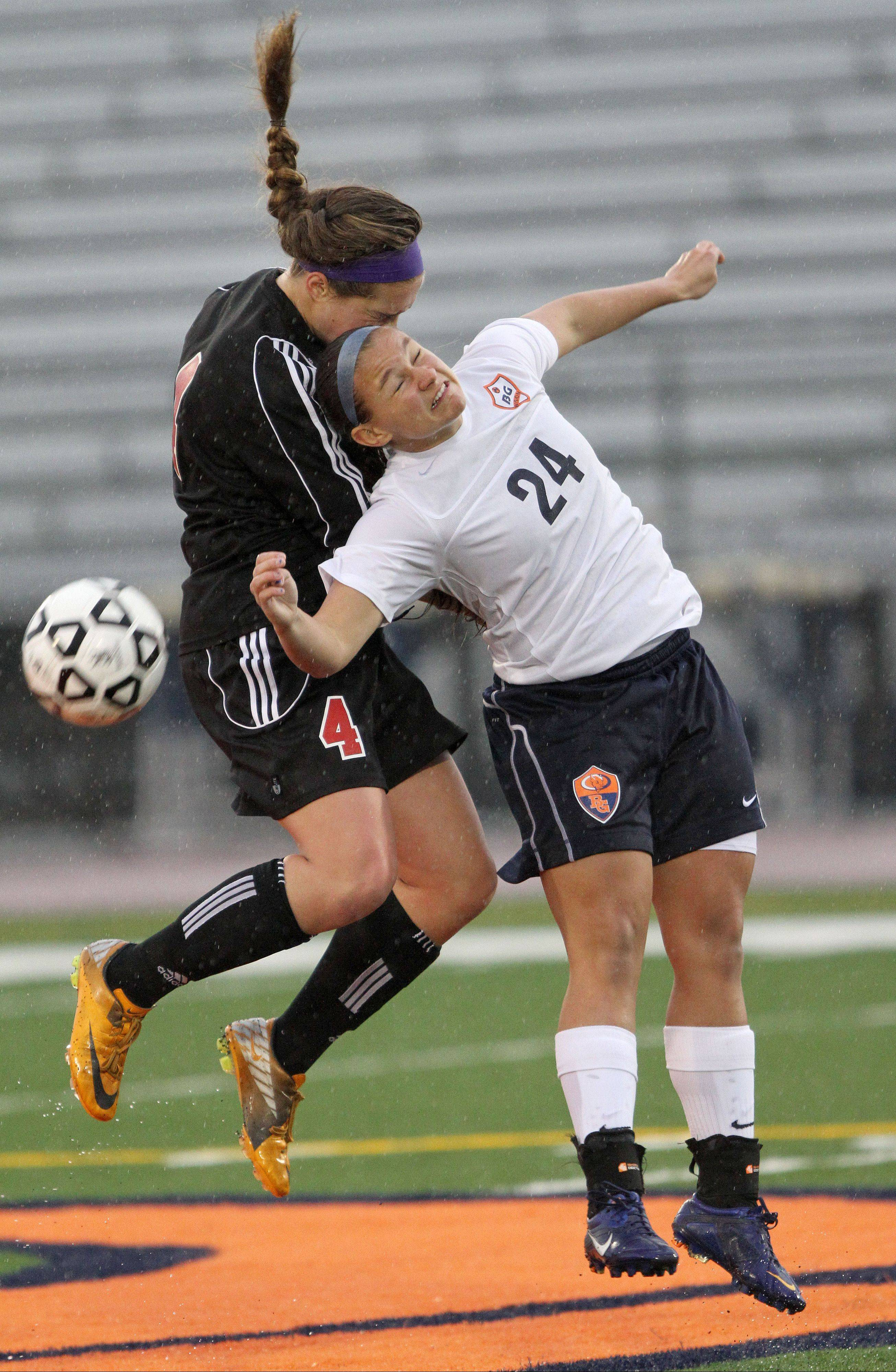 Barrington's Mia Calamari, left, and Buffalo Grove's Sara Busse go up for a header during Monday night's Mid-Suburban League contest at Buffalo Grove.