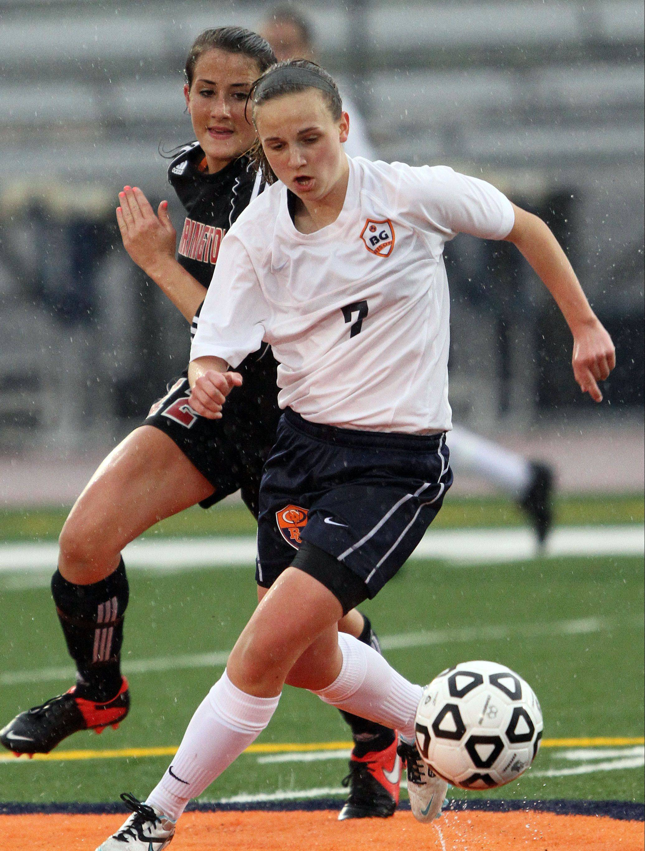 Buffalo Grove's Jessica Kovach, right, drives past Barrington's Megan Fox during Monday night at Buffalo Grove.