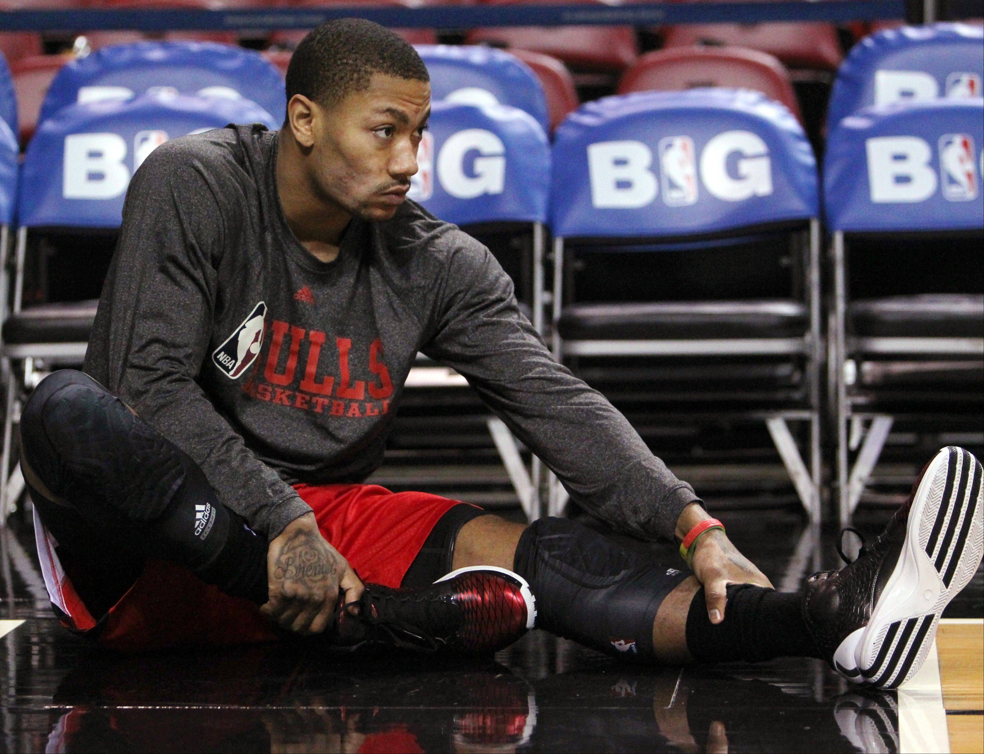 Derrick Rose stretches before the Bulls fell to the Heat 105-93 in Miami on Sunday afternoon. Having Rose return this season doesn't make much sense at this point, according to Daily Herald columnist Barry Rozner.
