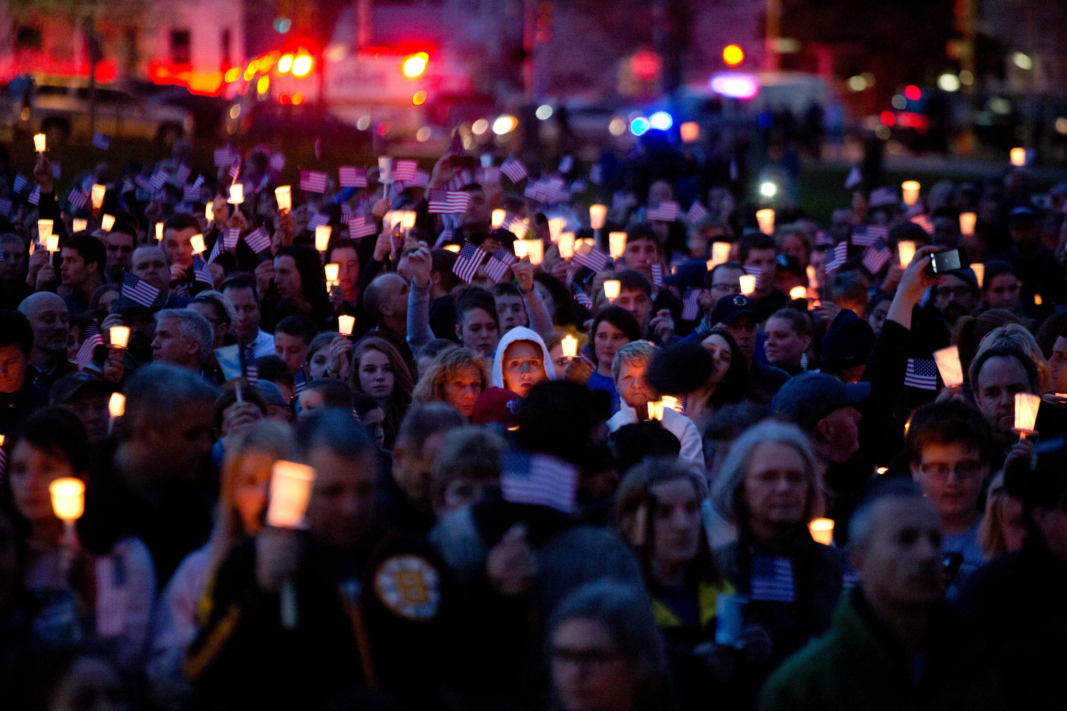 Mourners attend candlelight vigil for Martin Richard at Garvey Park, near Richard's home in the Dorchester section of Boston, on Tuesday, April 16, 2013. Martin is the 8-year-old boy killed in the Boston Marathon bombing.