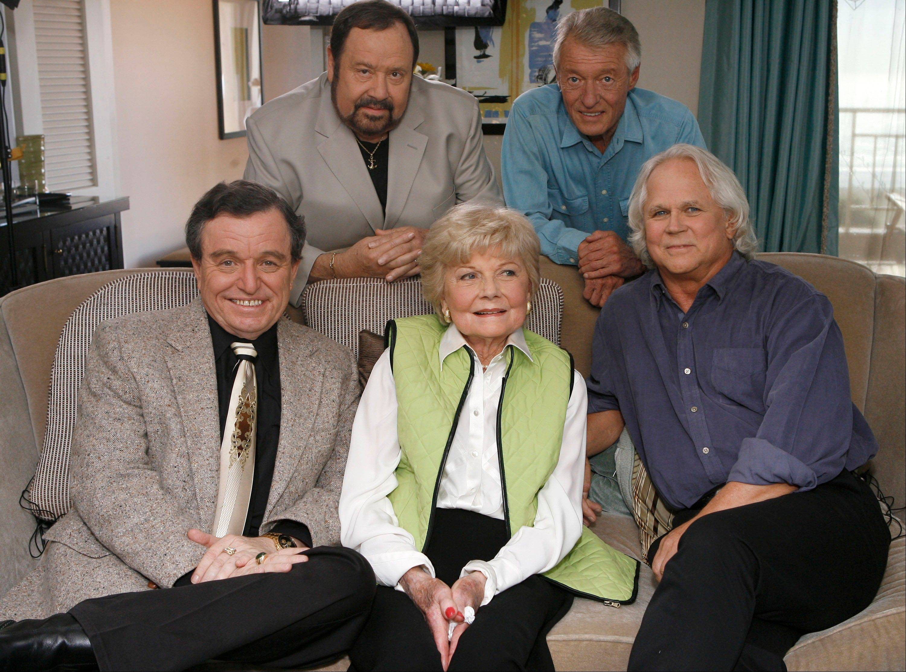 In this Sept. 27, 2007 file photo, seated, from left, Jerry Mathers, Barbara Billingsley and Tony Dow, and, standing from left, Frank Bank and Ken Osmond, pose for a photo as they are reunited to celebrate the 50th anniversary of the television show, �Leave it to Beaver,� in Santa Monica, Calif. Bank, who played oafish troublemaker Lumpy on the sitcom �Leave It to Beaver,� has died.