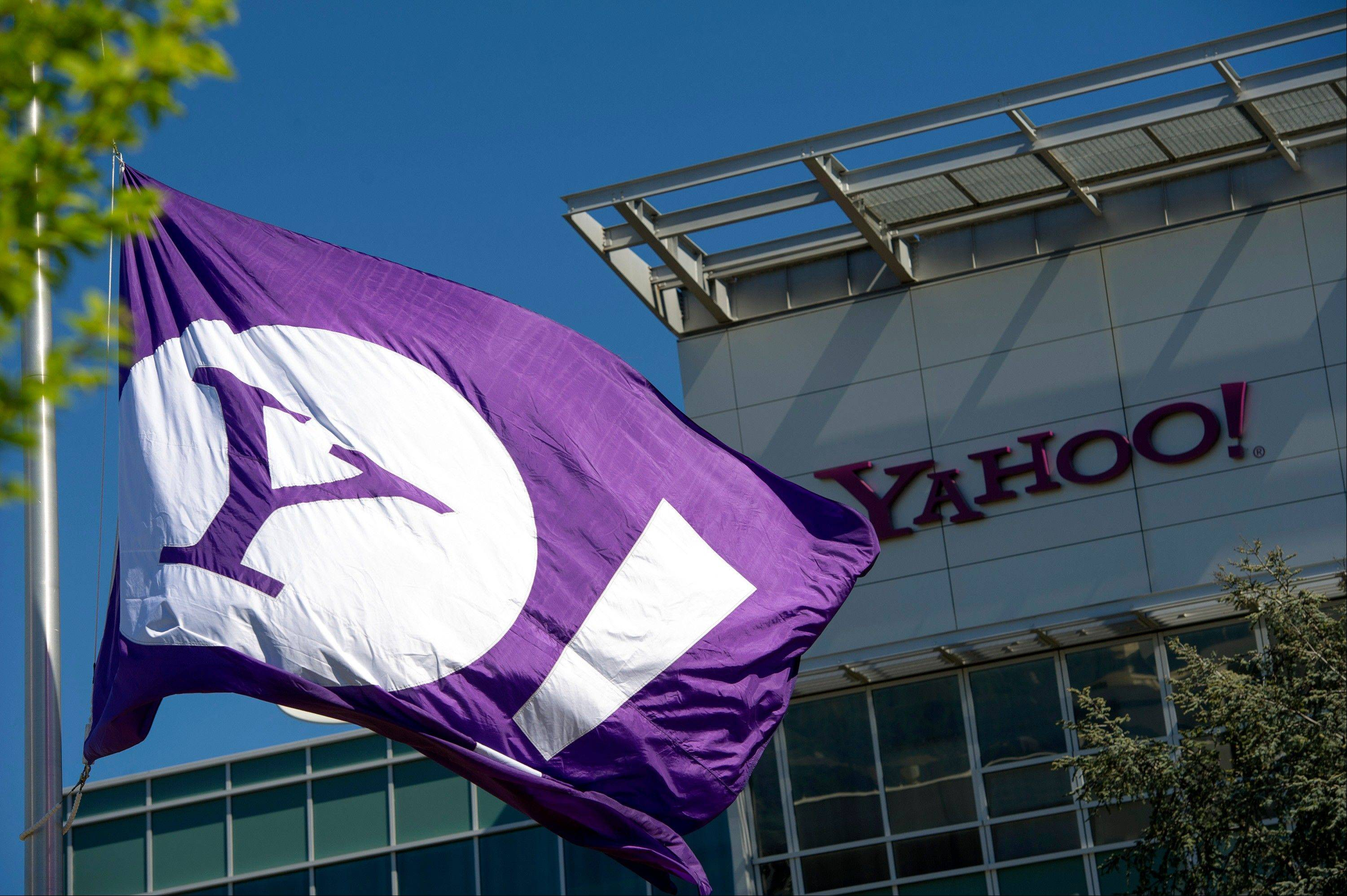 The Yahoo! Inc. logo is displayed on a flag flying at the company's headquarters in Sunnyvale, California, U.S., on Tuesday, April 16, 2013. Yahoo! Inc., the biggest U.S. Web portal, forecast sales that fell short of analysts� estimates as it continued to lose advertisers to Google Inc. and Facebook Inc. Photographer: David Paul Morris/Bloomberg