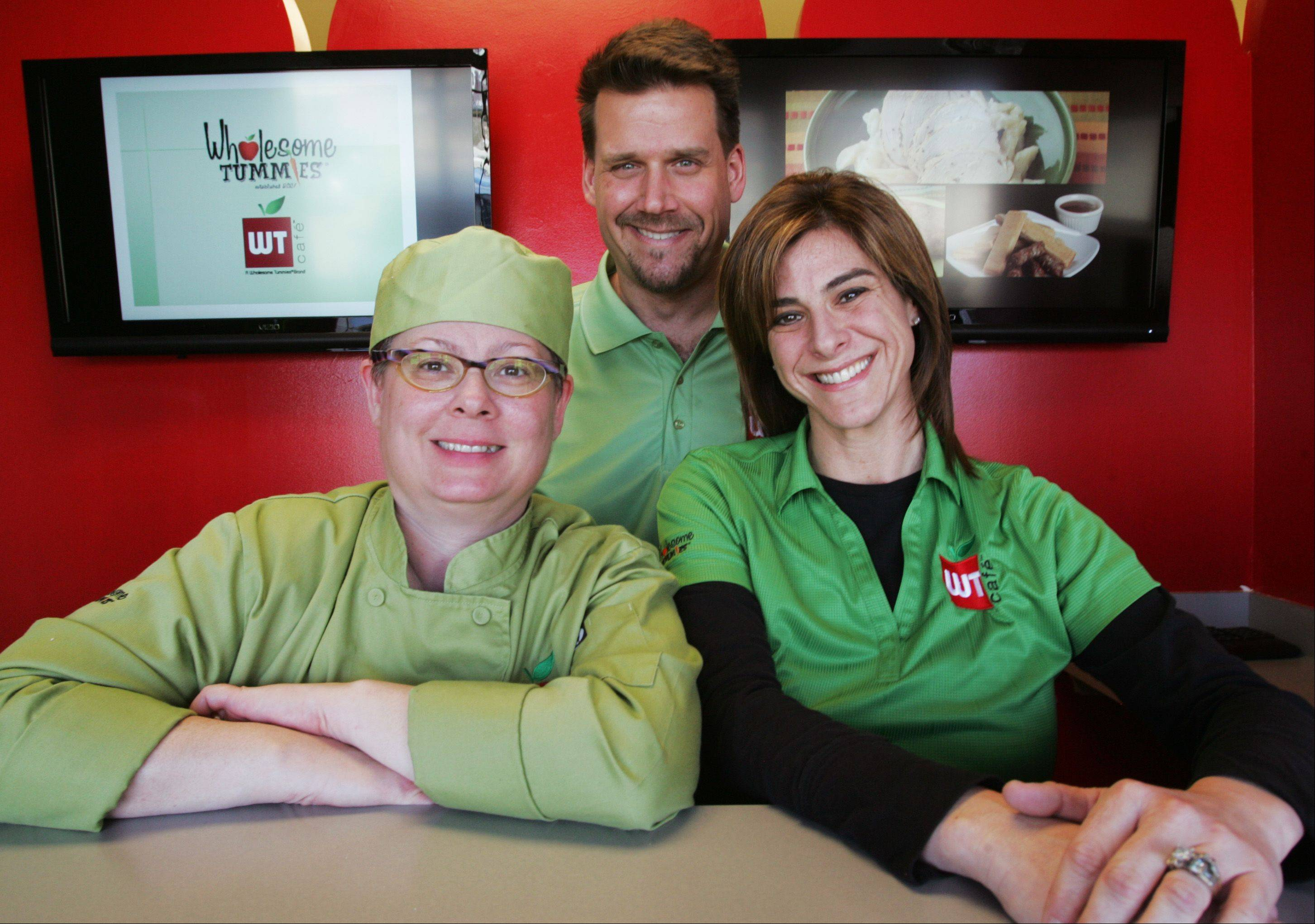 Jennifer Bychowsky, far right, and her husband Mike, started a franchise of Wholesome Tummies in January. The company specializes in kid-friendly healthy meals. Cathy Saso, left, is their chef.
