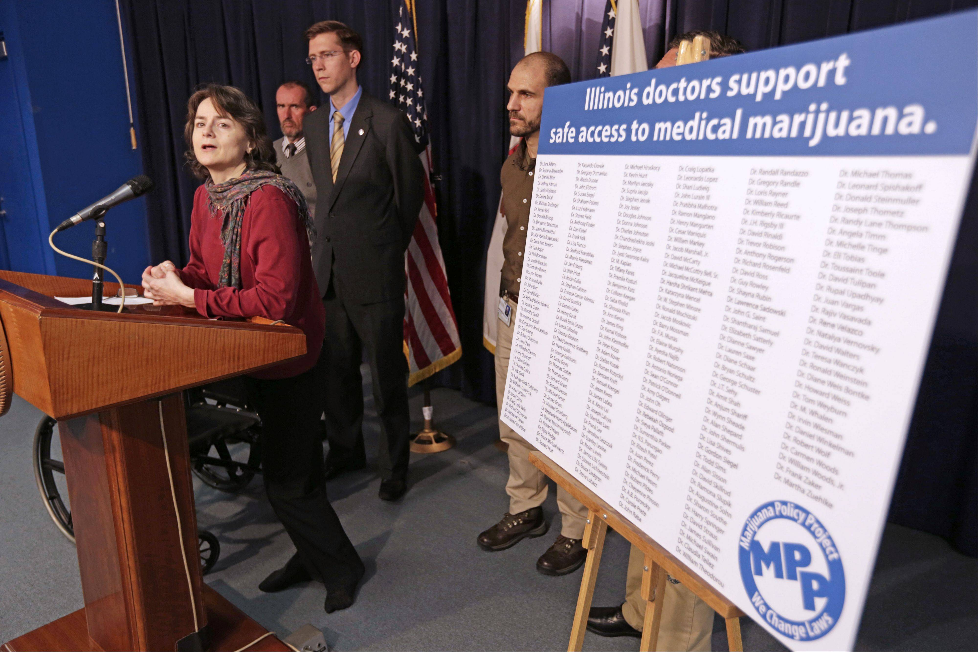 Julie Falco of Chicago speaks at a news conference held by the Marijuana Policy Project on Tuesday in Chicago. Falco uses marijuana to treat multiple sclerosis symptoms and says she and other patients shouldn't be considered criminals for trying to ease their suffering.
