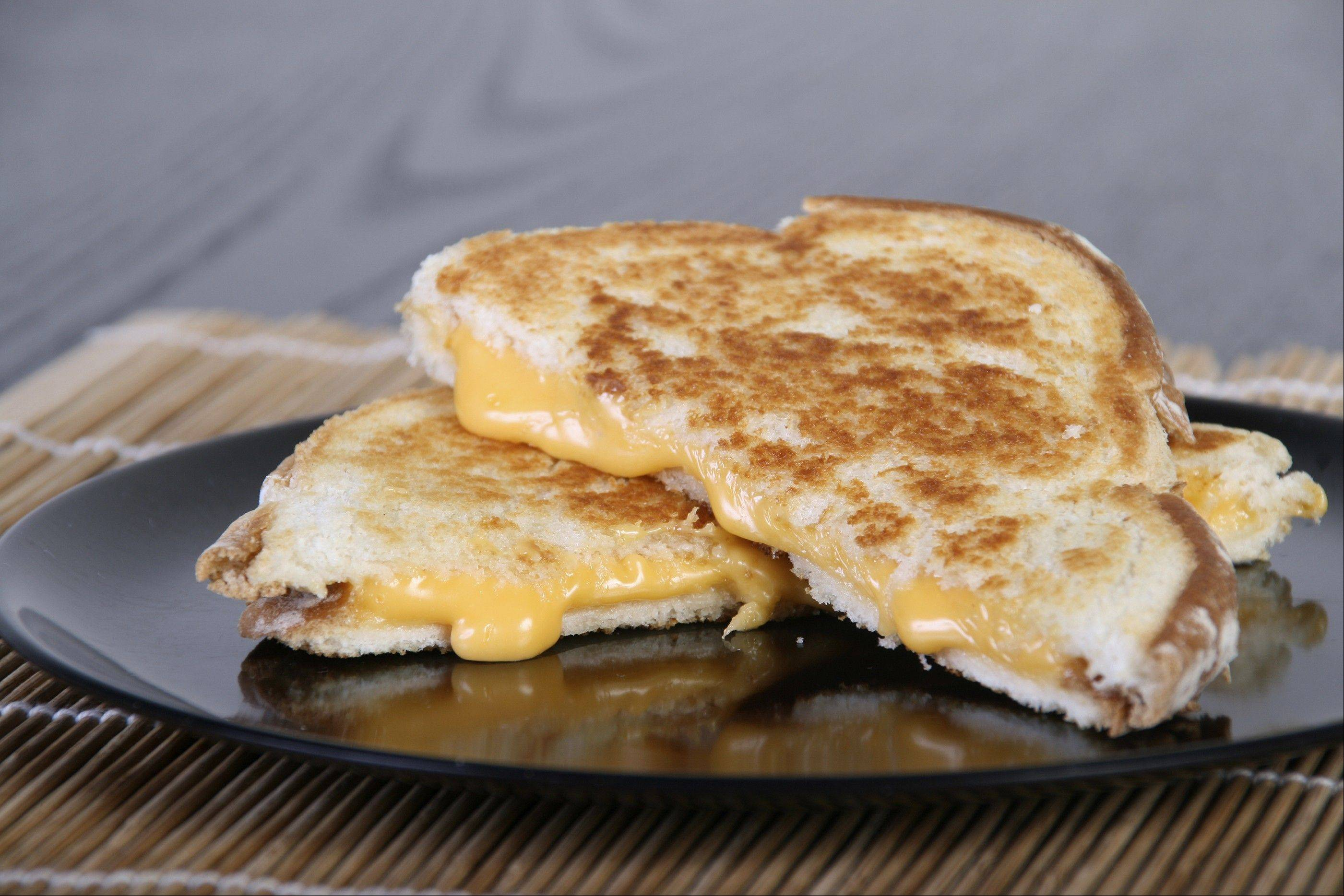 The four competition categories at the Wisconsin Grilled Cheese Championship are classic bread and cheese; classic plus one ingredient; classic plus extras; and a classic dessert sandwich.