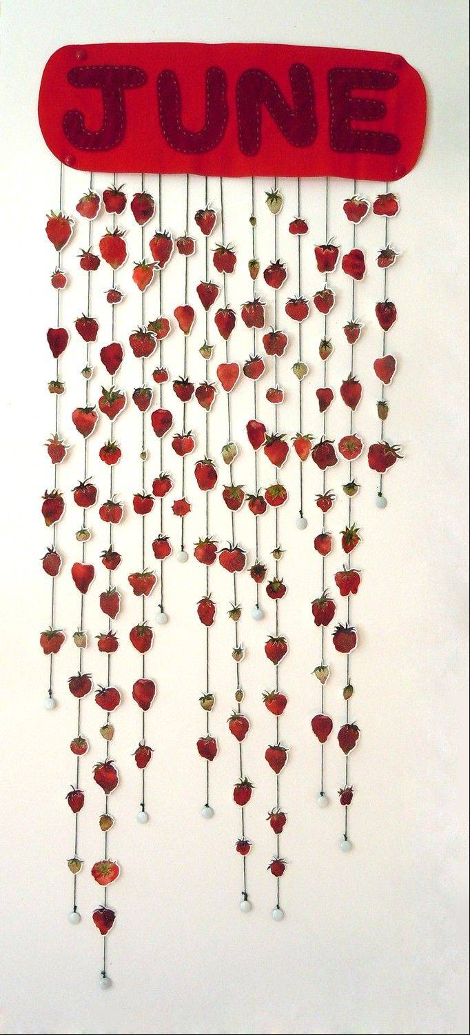 "Kim Guare's work, ""Harvesting the Strawberry in the Midwest,"" depicts the fruit at its peak in June."