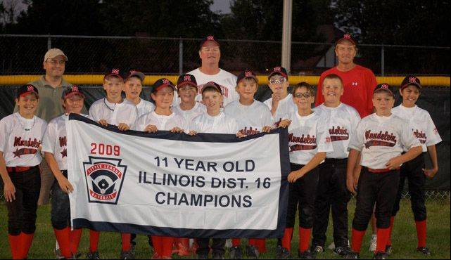 "Mike Jones, back right, with one of Mundelein's youth baseball teams. Jones died about six months ago, and Mundelein Baseball and Softball Association is raising funds to build the ""Red Monster"" wall in his honor."