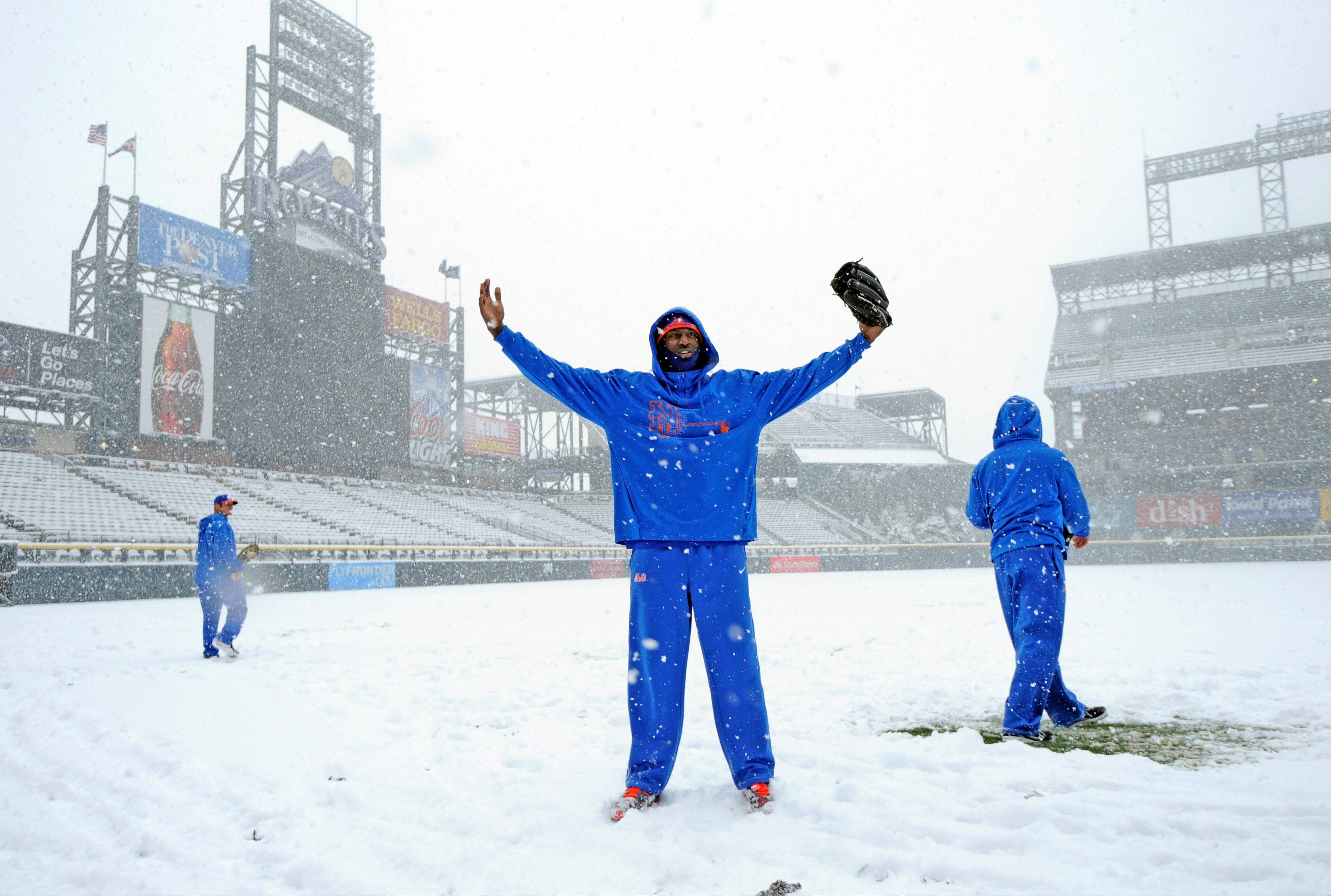 New York Mets pitcher LaTroy Hawkins poses in the snow before a scheduled baseball game against the Colorado Rockies, Monday, April 15, 2013, in Denver. The game was canceled.