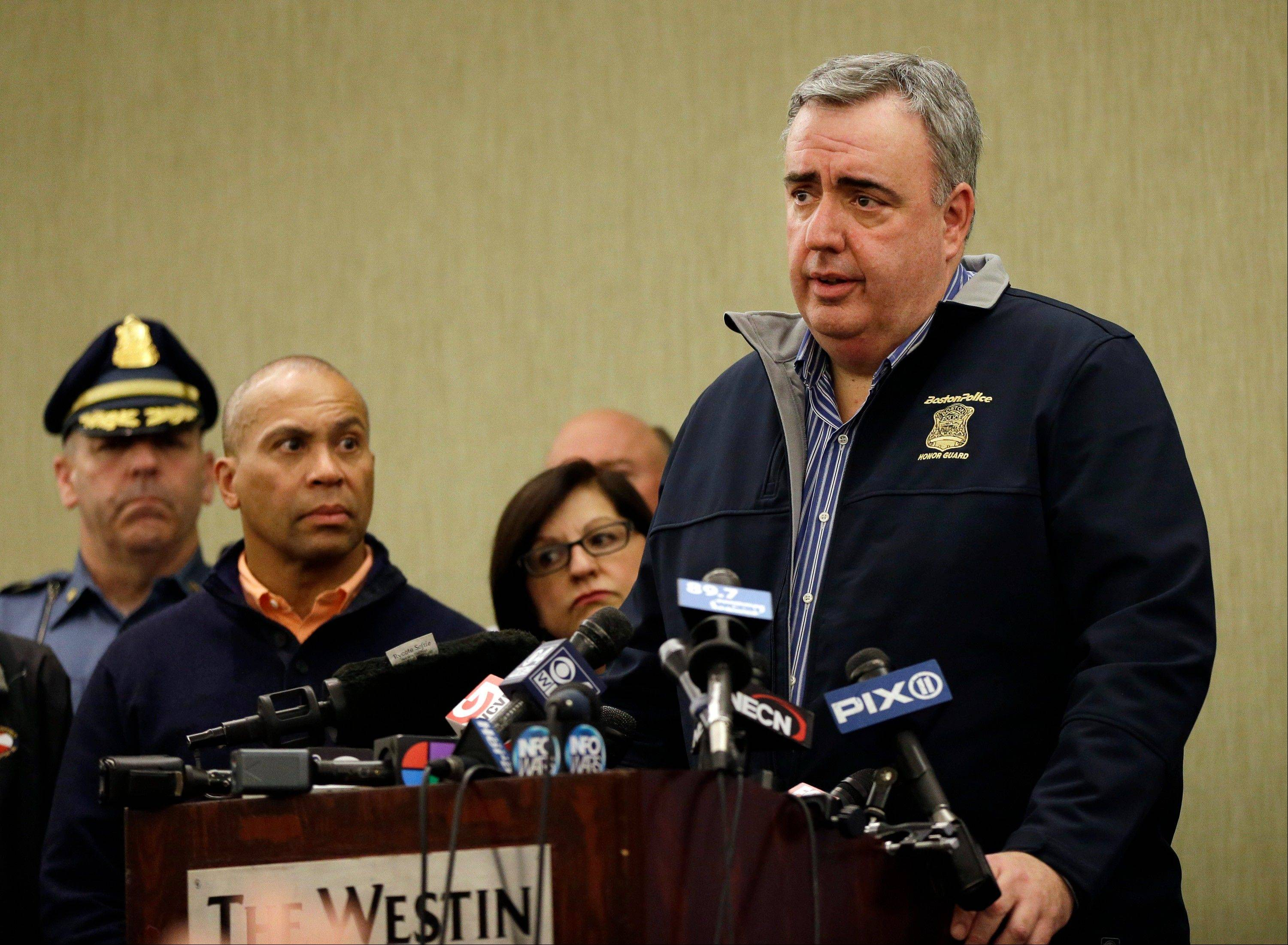 Boston Police Commissioner Ed Davis speaks Monday as Massachusetts Gov. Deval Patrick listens, second from left, at a news conference in Boston regarding two bombs which exploded in the street near the finish line of the Boston Marathon on Monday, killing three people and injuring more than 130.