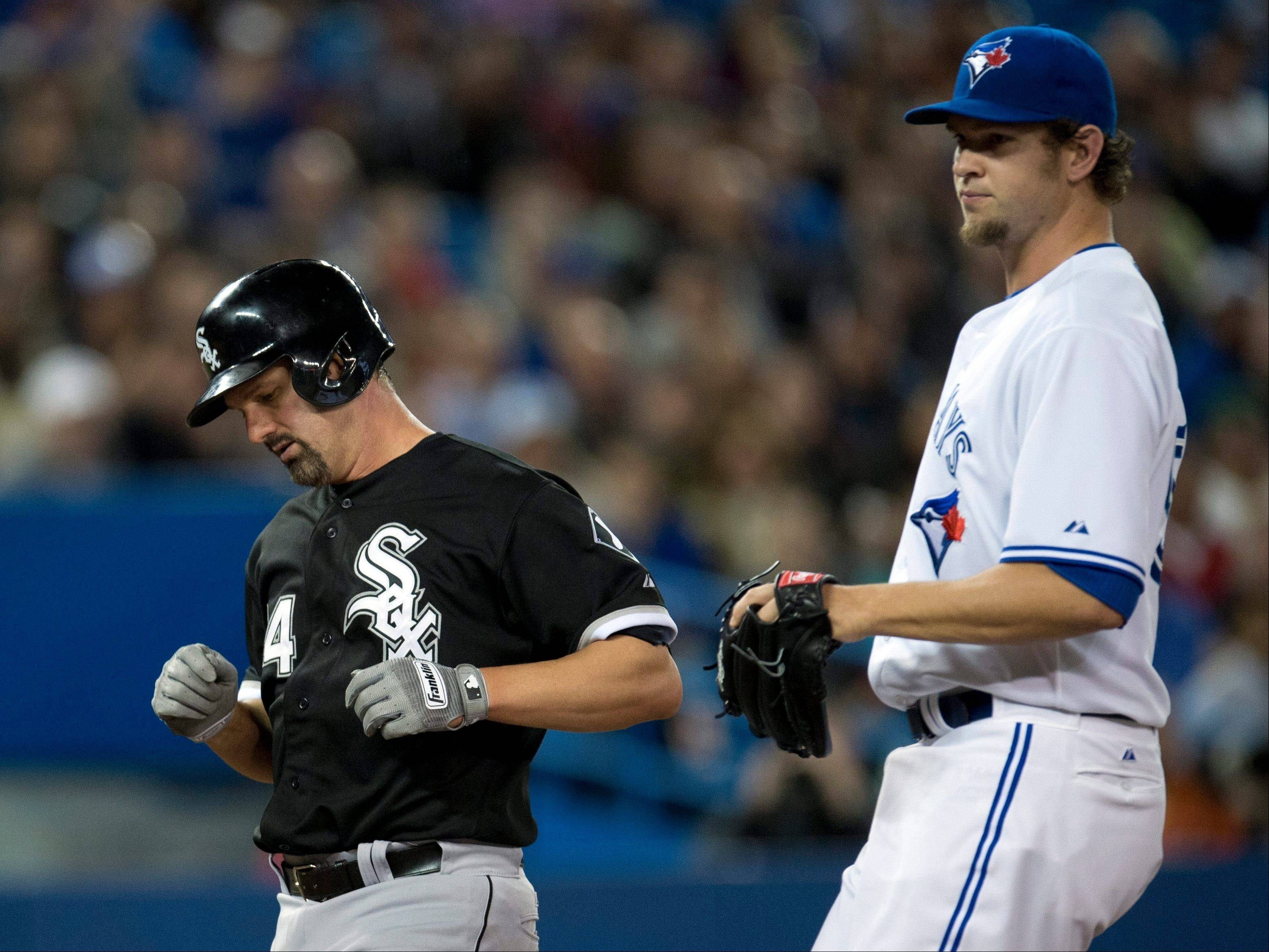 Toronto Blue Jays' Colby Rasmus, right, celebrates his solo home run as he crosses the plate in front of Chicago White Sox catcher Hector Gimenez Tuesday night in Toronto. The Sox won 4-3.