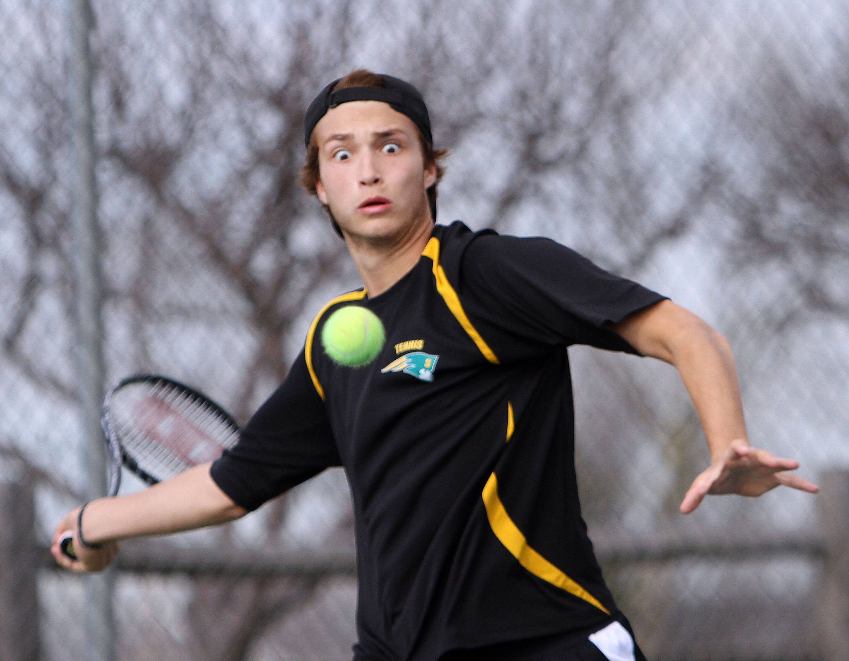Stevenon's Colin Harvey concentrates on hitting a forehand against Warren on Tuesday in Gurnee.