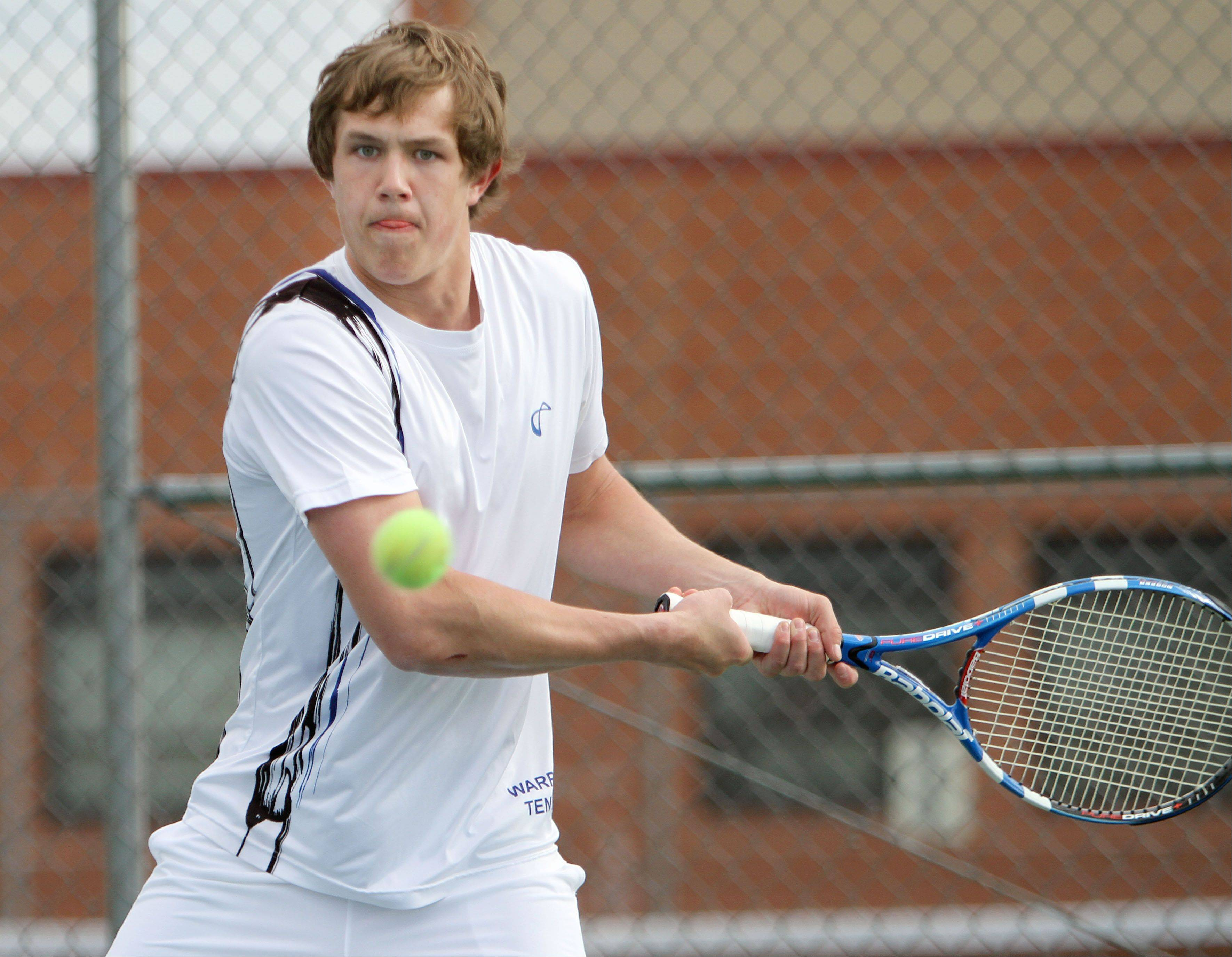 Warren's Matt Matheny returns a serve during his doubles match against Stevenson on Tuesday at Warren.