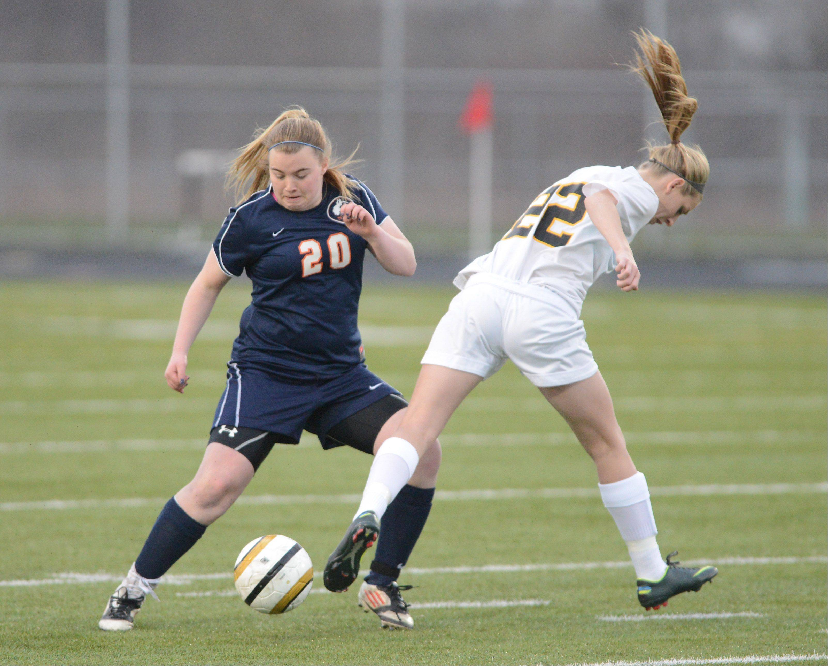 Emily Bromagen of Naperville North and Jenna Kentgen of Metea Valley took part in the Naperville North at Metea Valley girls soccer game Tuesday.
