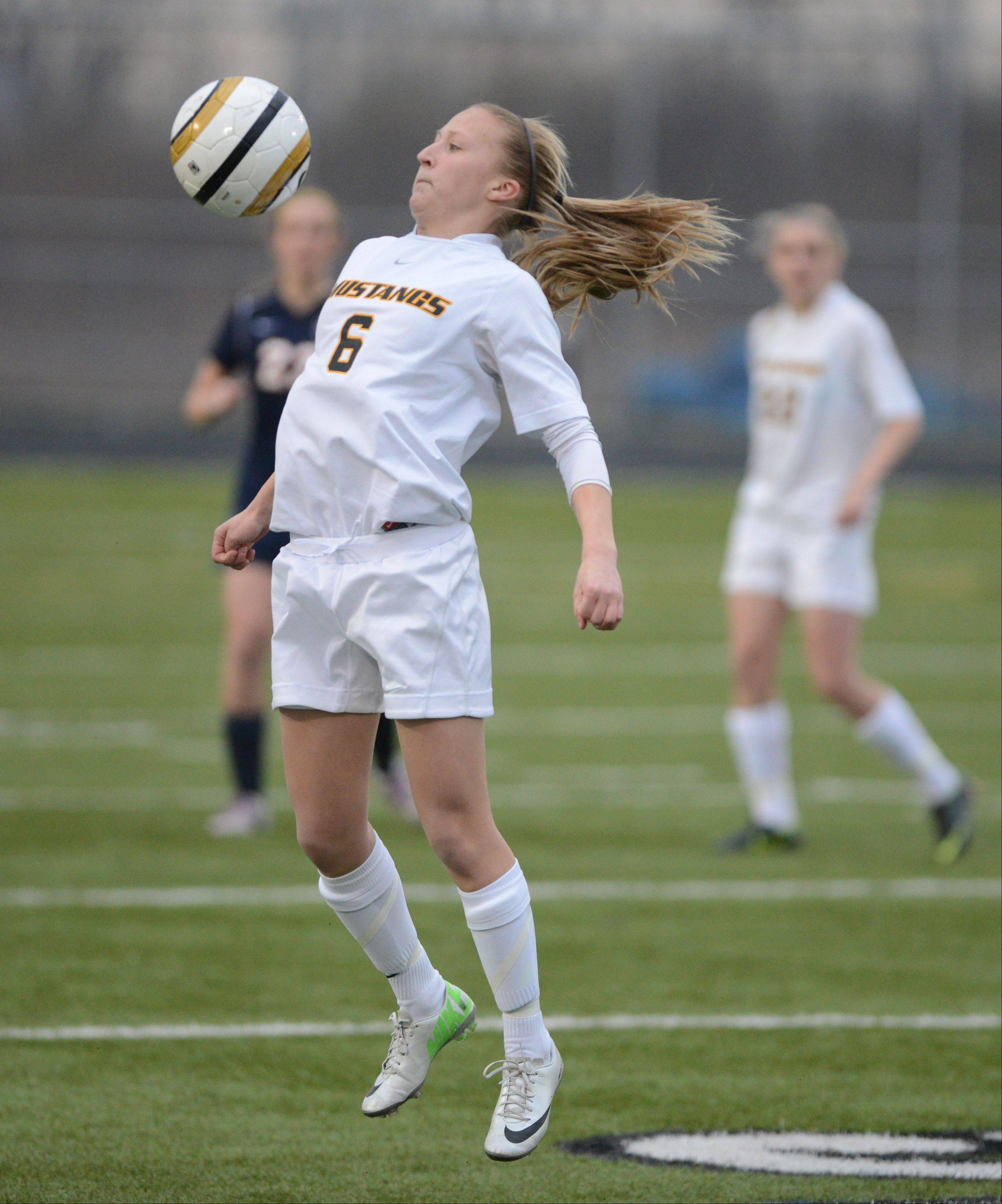 Alena Sidwell of Metea Valley works the ball during the Naperville North at Metea Valley girls soccer game Tuesday.