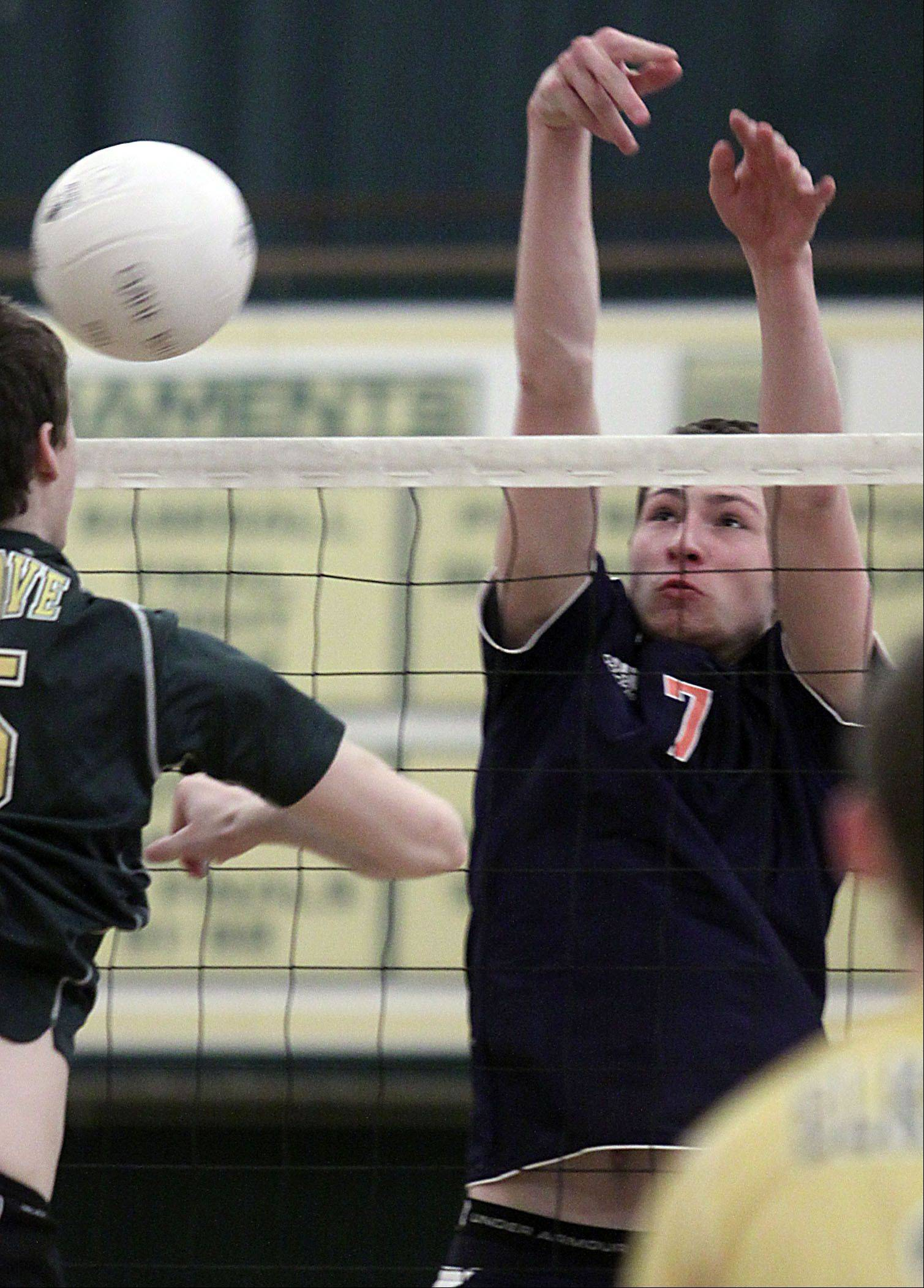 Elk Grove's Sam Jasutis, goes on the attack opposite Buffalo Grove's Nikita Balauski, right, Tuesday at Elk Grove.