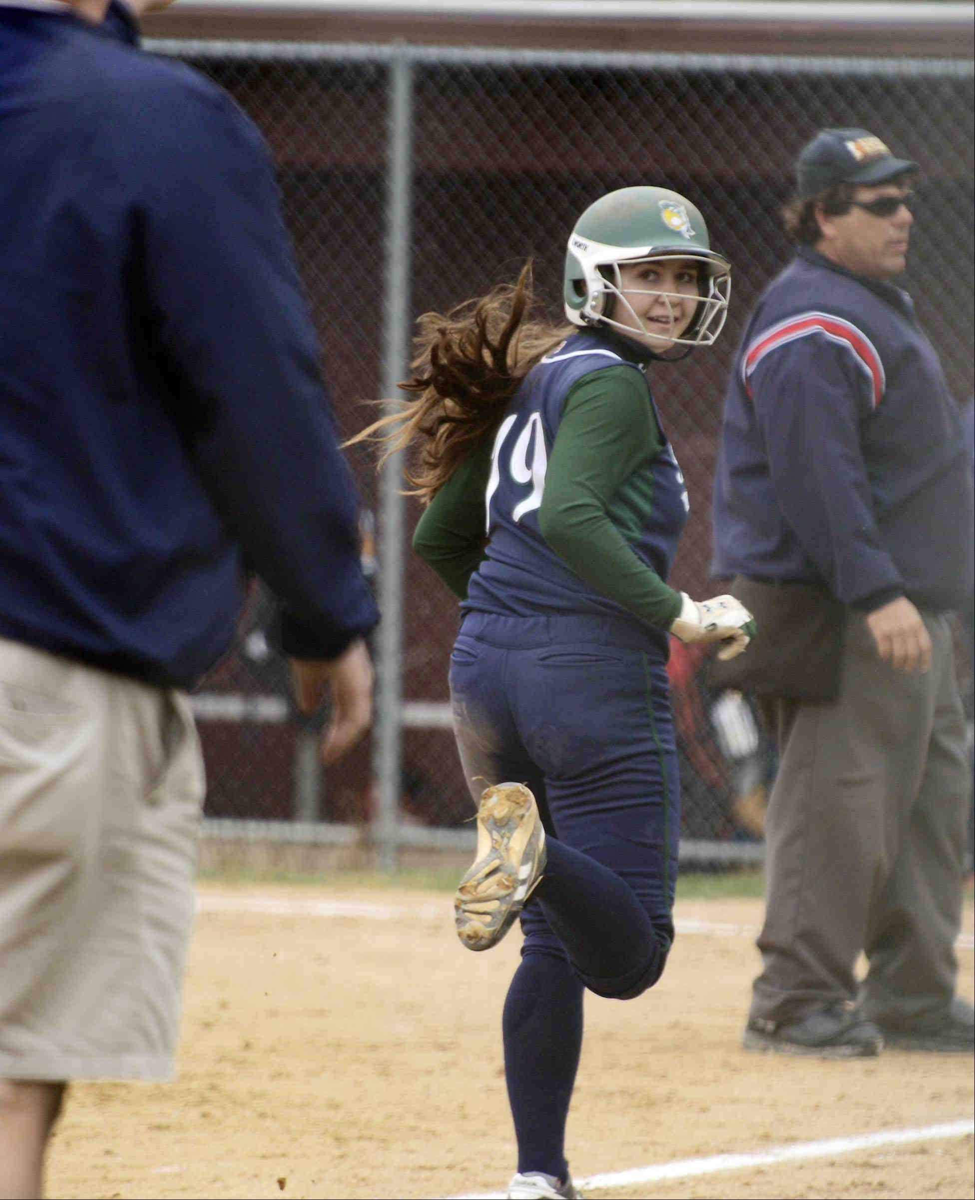 Bartlett's Kayla Haberstich looks back at Hawks' coach Jim Wolfsmith after hitting a home run Tuesday in Elgin.