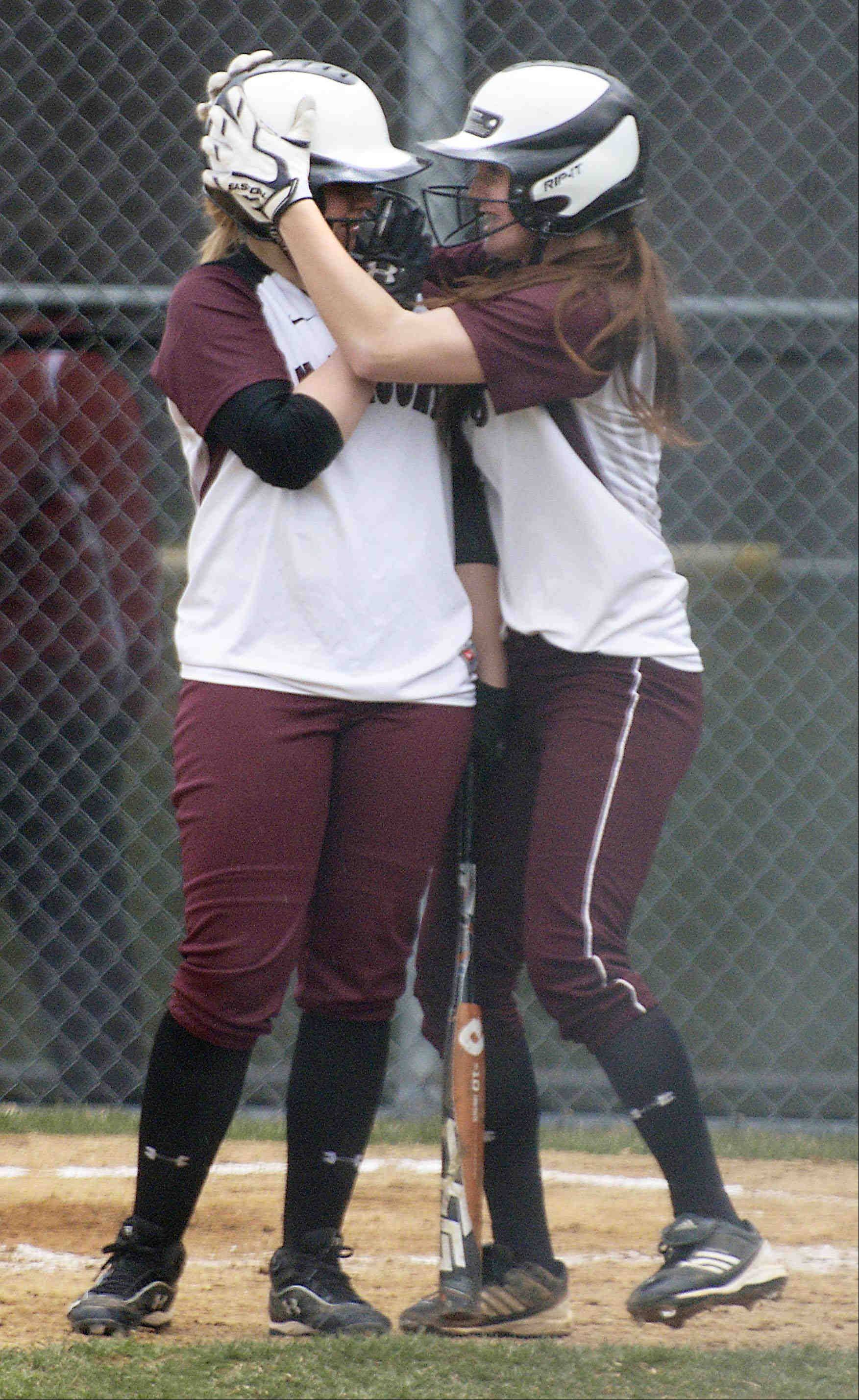 Elgin's Jennah Perryman encourages teammate Anna Eckholm before her at bat against Bartlett Tuesday in Elgin.