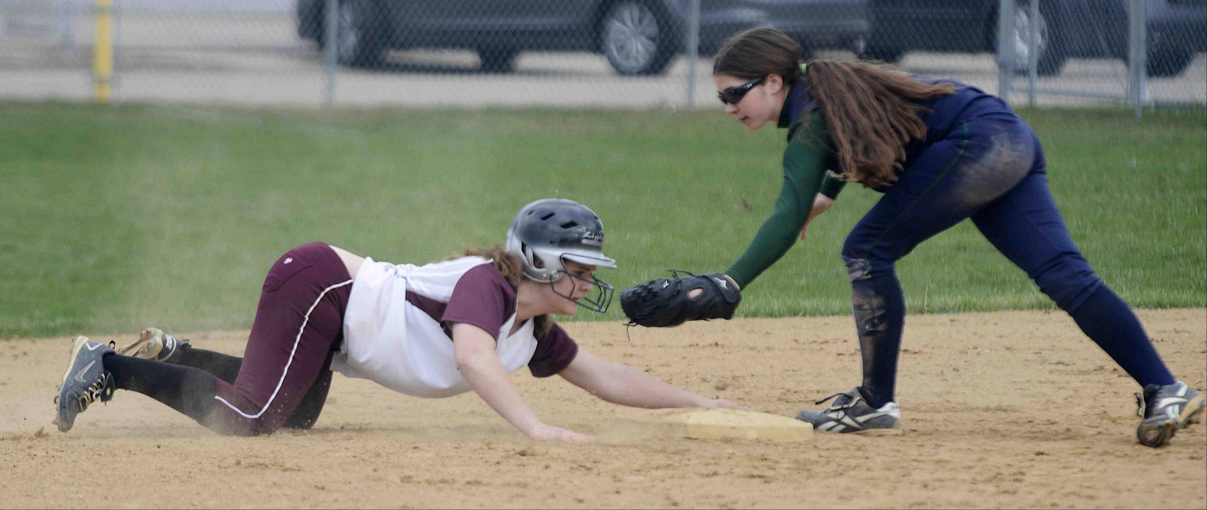 Elgin's Anna Eckholm holds safely onto second base as Bartlett's Katie Fornoff checks her Tuesday in Elgin.