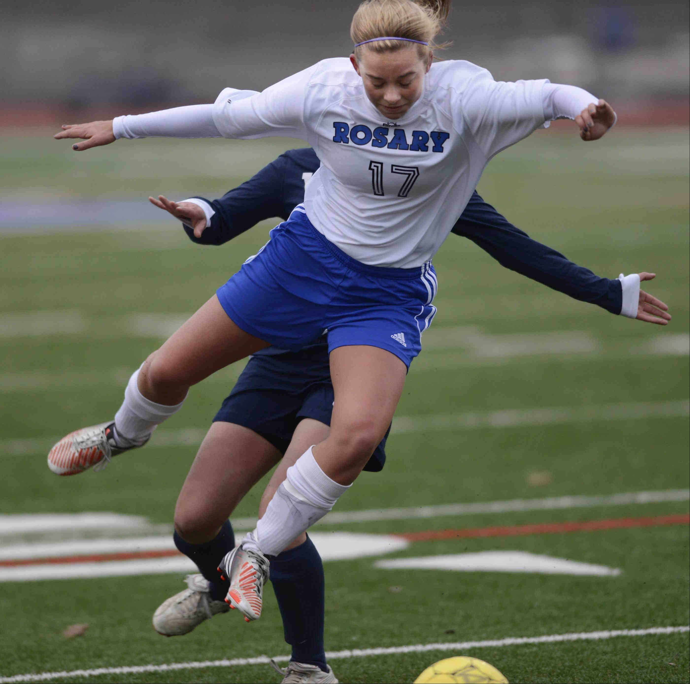 Rosary's Taylor Gibson skips over the defense of West Aurora's Catalina Campos Wednesday in Aurora.