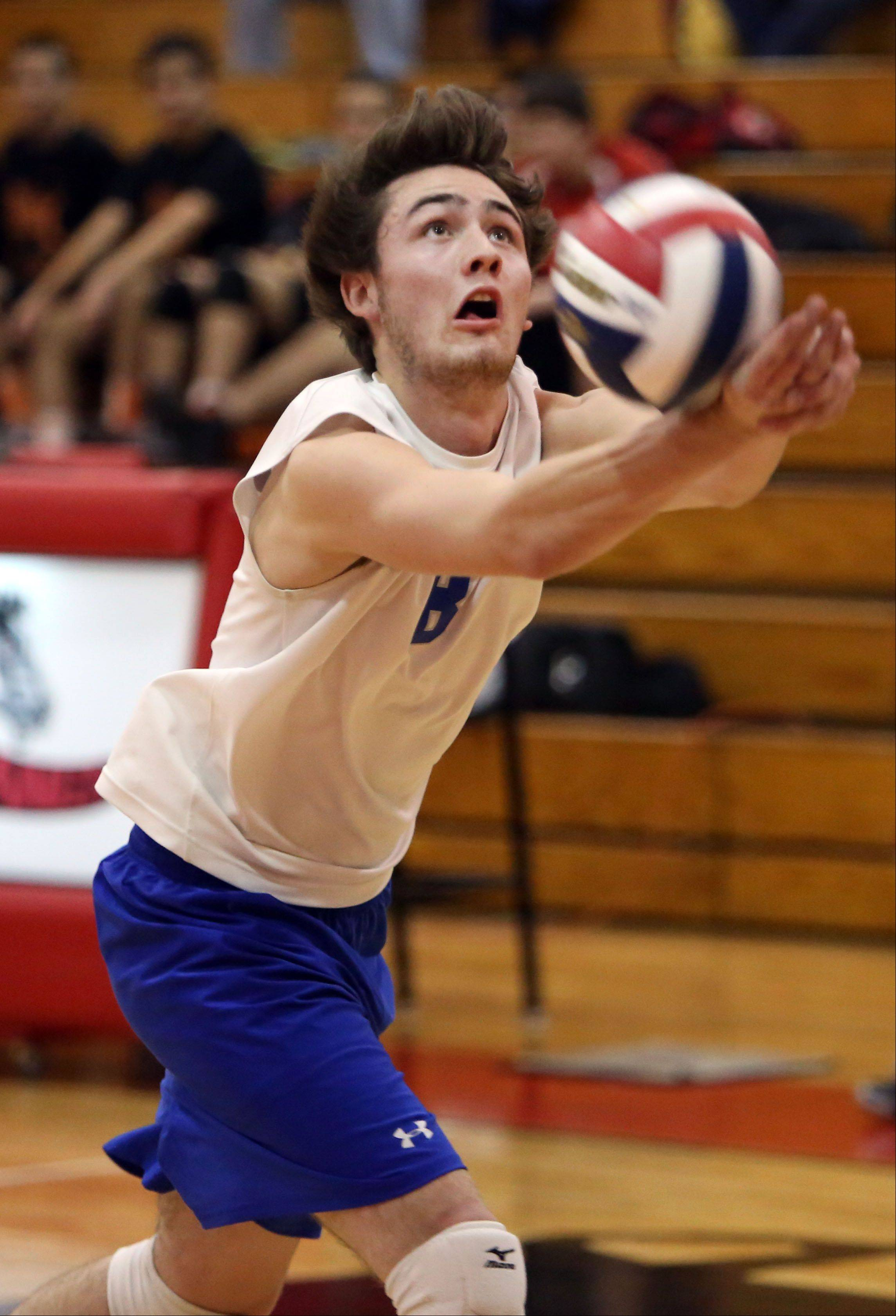 Vernon Hills' Ryan Opitz tracks down a stray ball during their game Wednesday night in Mundelein.