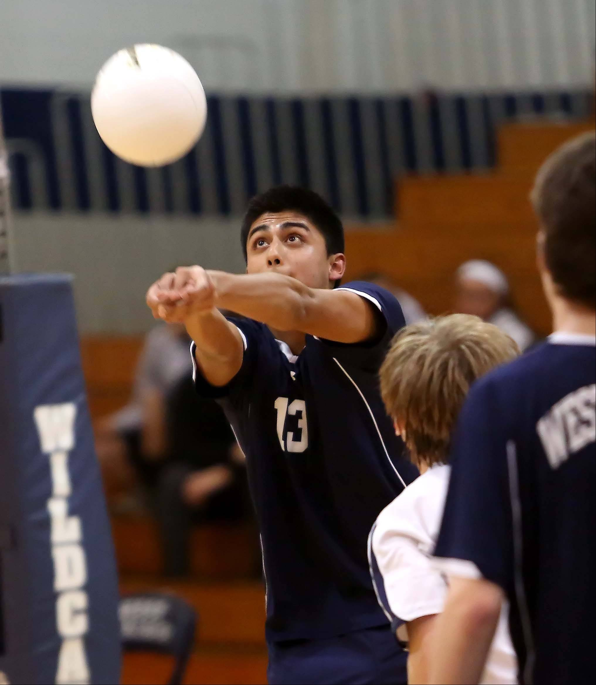 West Chicago's Danny Amaro returns the ball against Naperville North Tuesday in West Chicago.