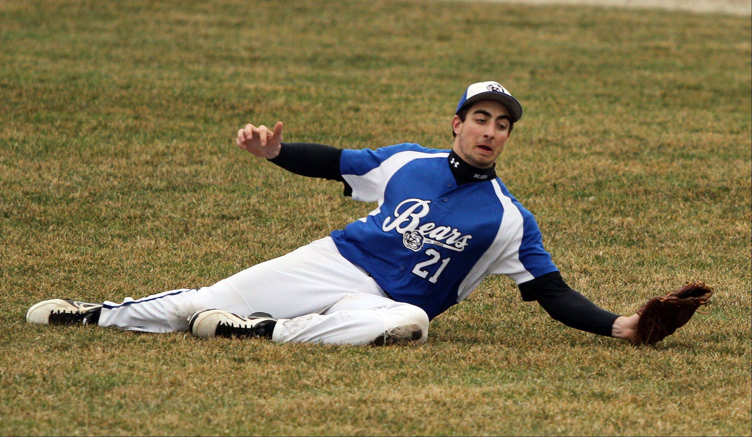 Lake Zurich's Dominic DeMicco makes a diving catch in the outfield during Tuesday's game at Mundelein High School.