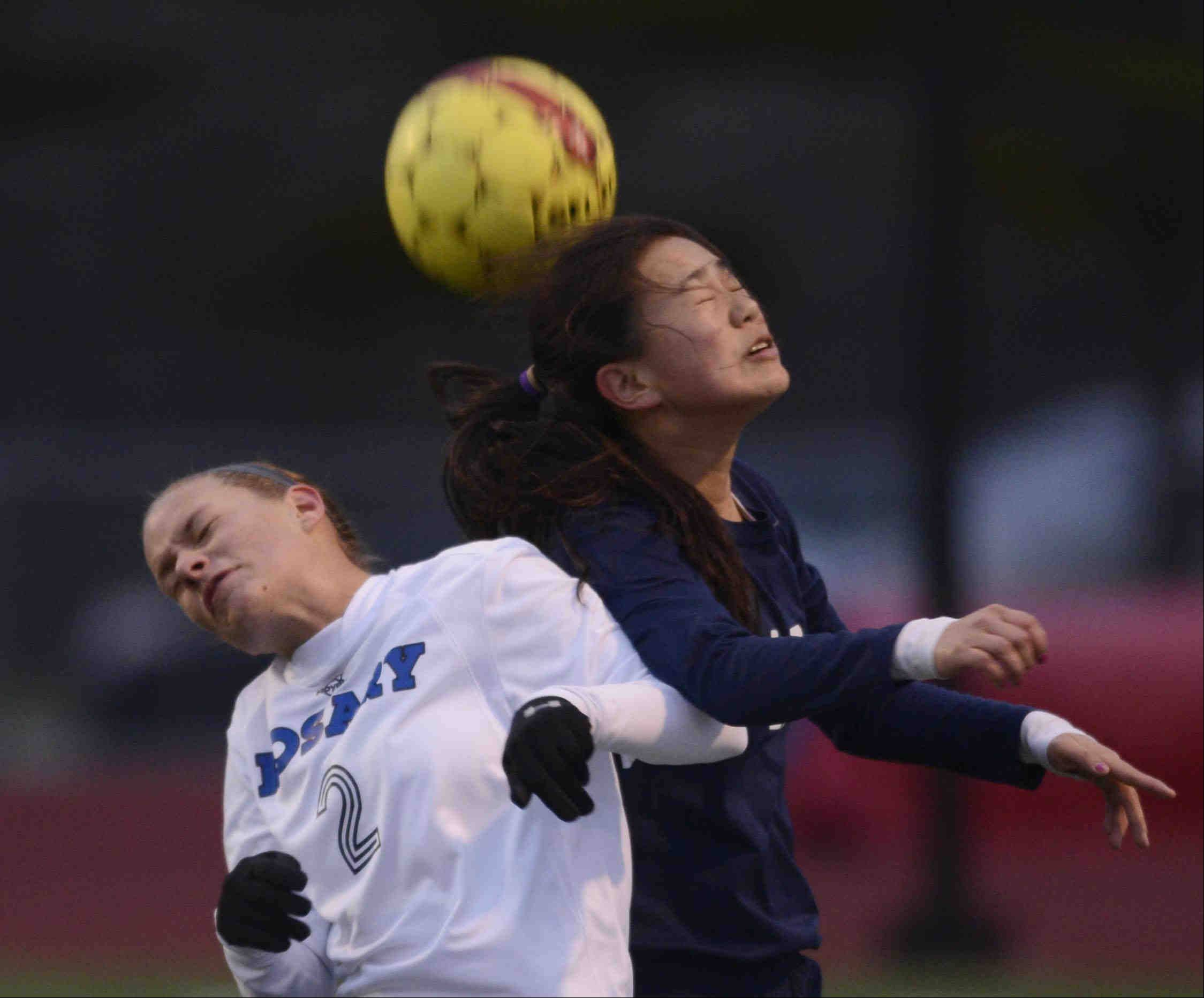 Rosary's Molly Piech and West Aurora's Carli Hix collide as they compete for a header Wednesday in Aurora.