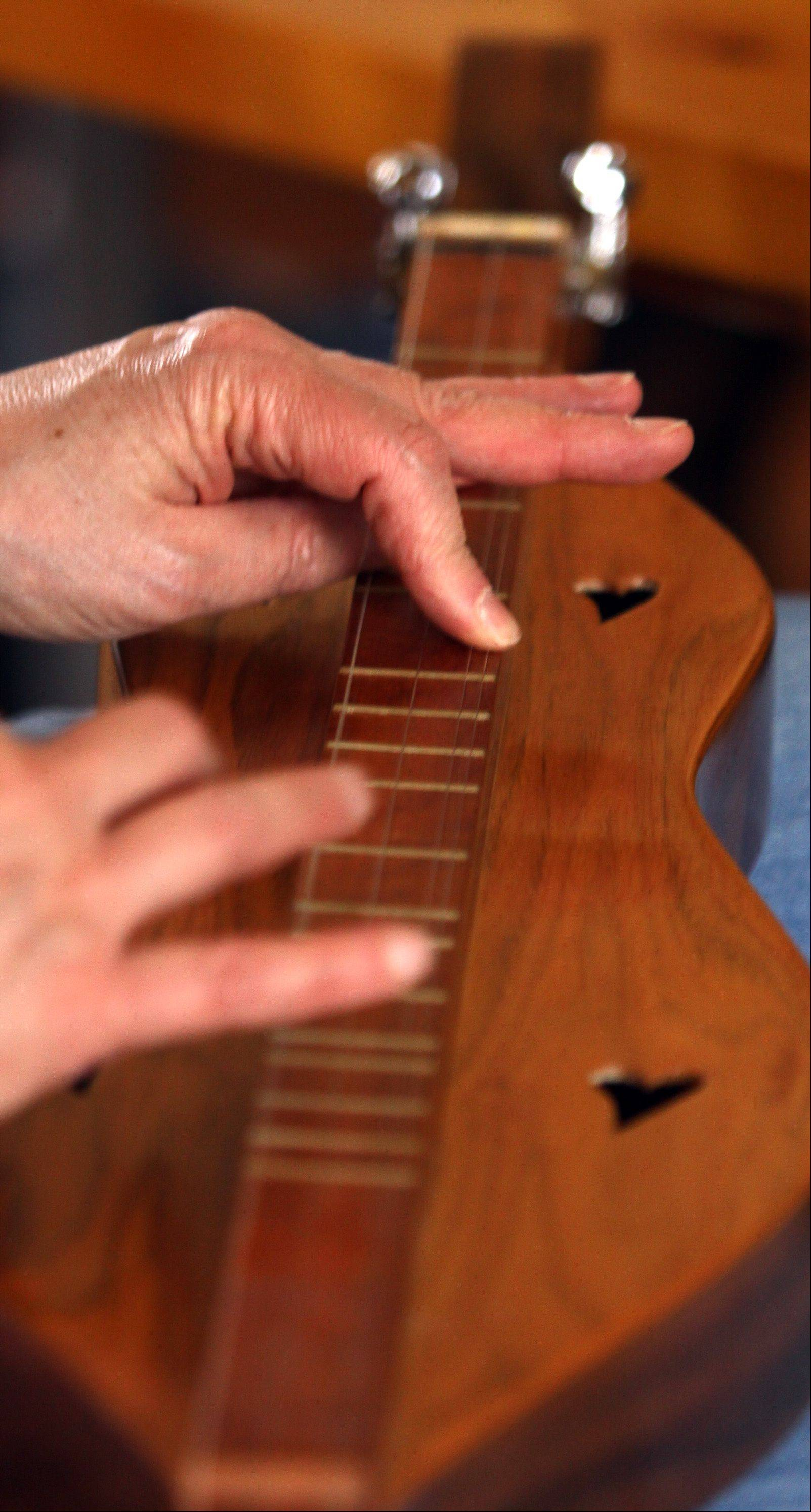 "Dona Benkert of the Folk-Lore Center music school will demonstrate strumming a mountain dulcimer during the ""Hands On Dulcimer Workshop"" at Garfield Farm Museum."