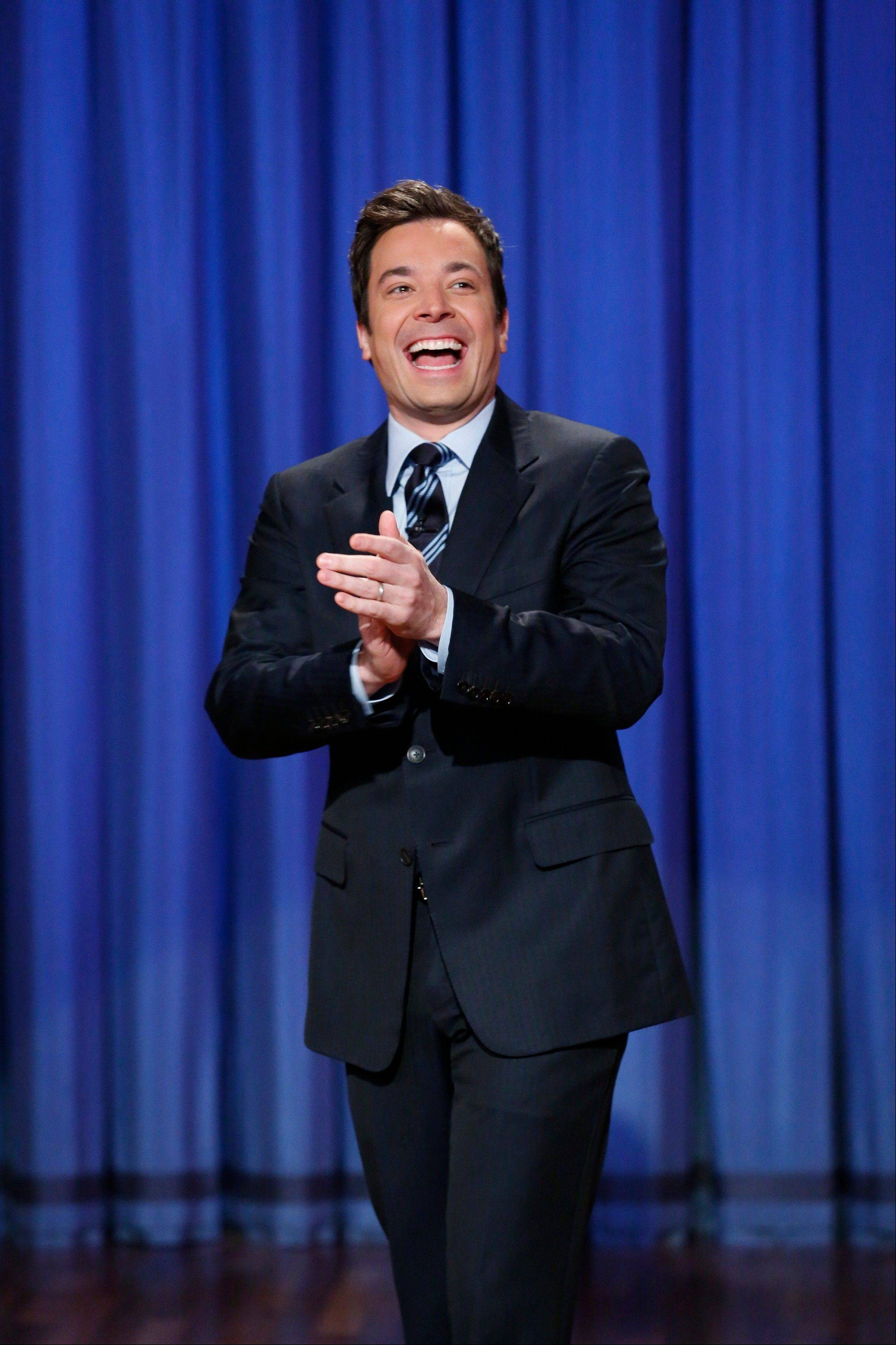 "This April 4, 2013 photo released by NBC shows Jimmy Fallon, host of ""Late Night with Jimmy Fallon,"" in New York. Lorne Michaels, longtime producer of ""Saturday Night Live"" says NBC's ""Tonight Show"" is moving back to New York because it's the right place for Fallon, who will take over the hosting job next year."