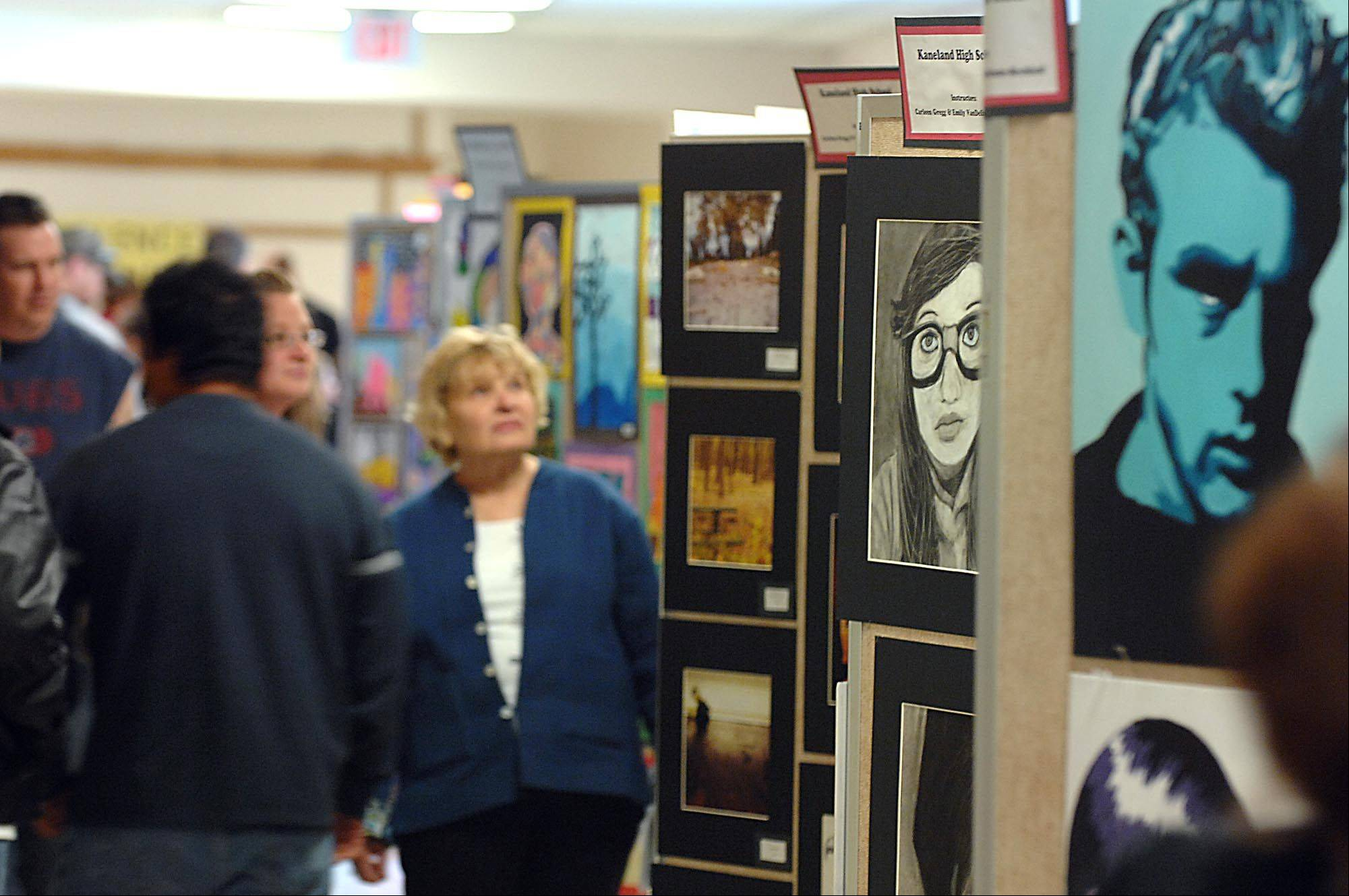 Visitors check out student artwork at the 13th annual Kaneland Community Fine Arts Festival at Kaneland High School. This year's festival is set for Sunday, April 21.