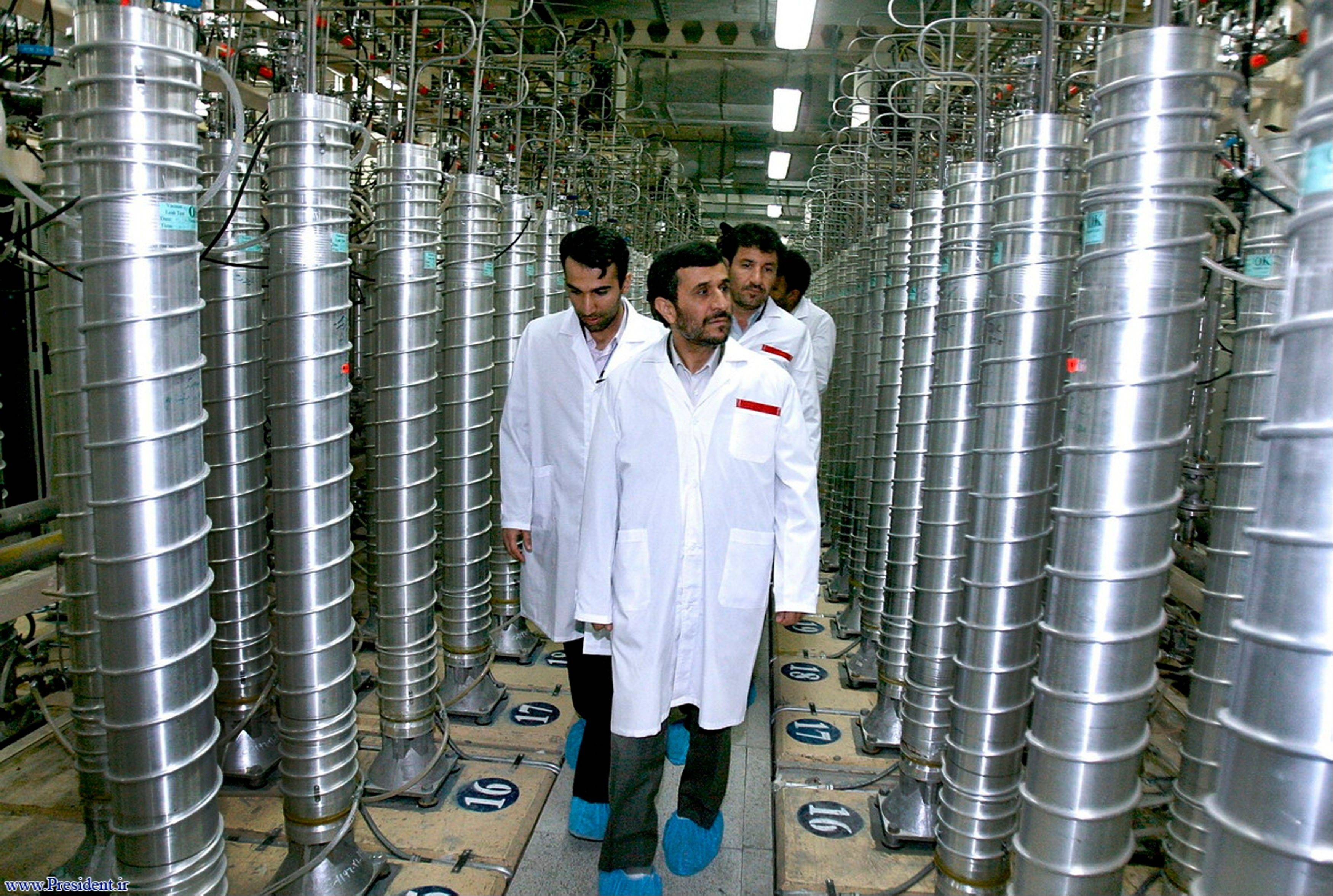 In this 2008 photo, Iranian President Mahmoud Ahmadinejad visits the Natanz Uranium Enrichment Facility. Technicians upgrading Iran's main uranium enrichment facility have tripled partial or full installations of high-tech machines that could be used in a nuclear weapons program to more than 600 since starting their work three months ago, according to diplomats.