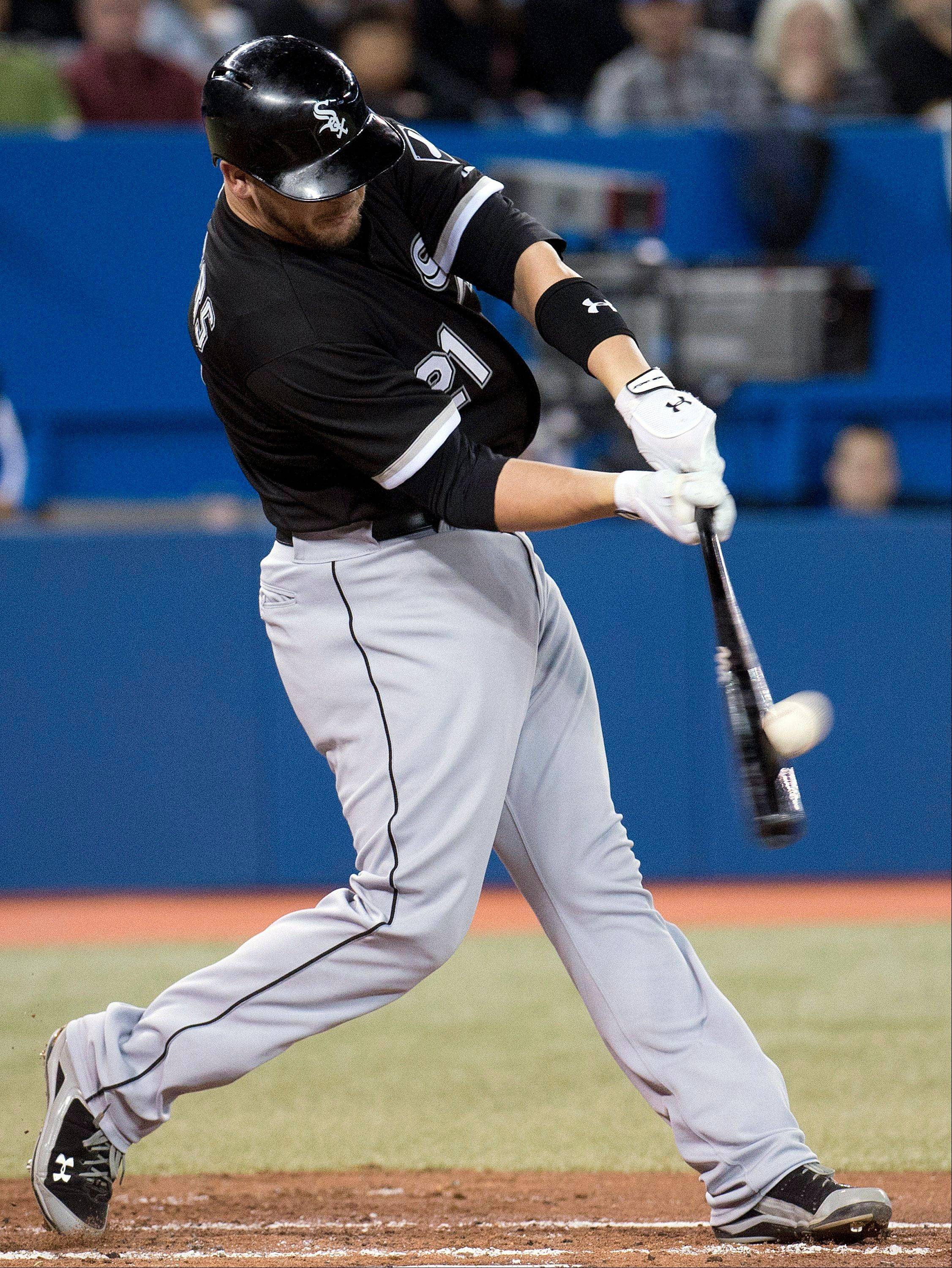 The White Sox' Tyler Flowers blasts a 3-run homer in the second inning Wednesday against the Blue Jays in Toronto.