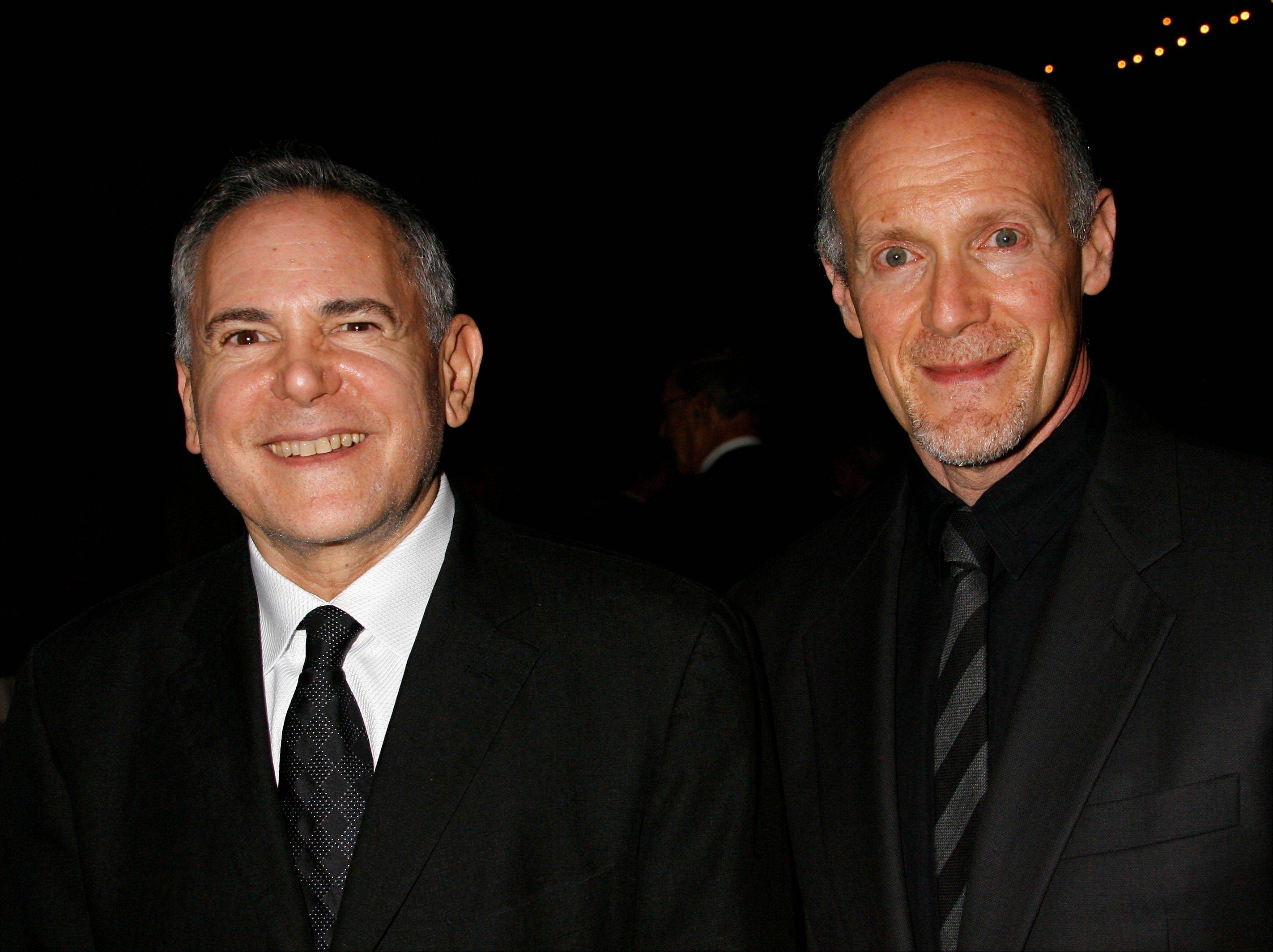 "This Nov. 15, 2007 file photo shows Craig Zadan, left, and Neil Meron, producers of the film ""Hairspray"" at the Santa Barbara International Film Festival's Kirk Douglas Award for Excellence in Film presented to actor John Travolta in Santa Barbara, Calif. Zadan and Meron will produce the Oscars again. The film academy announced Tuesday, April 17, 2013, that it has invited Zadan and Meron to return for the 2014 Academy Awards telecast."