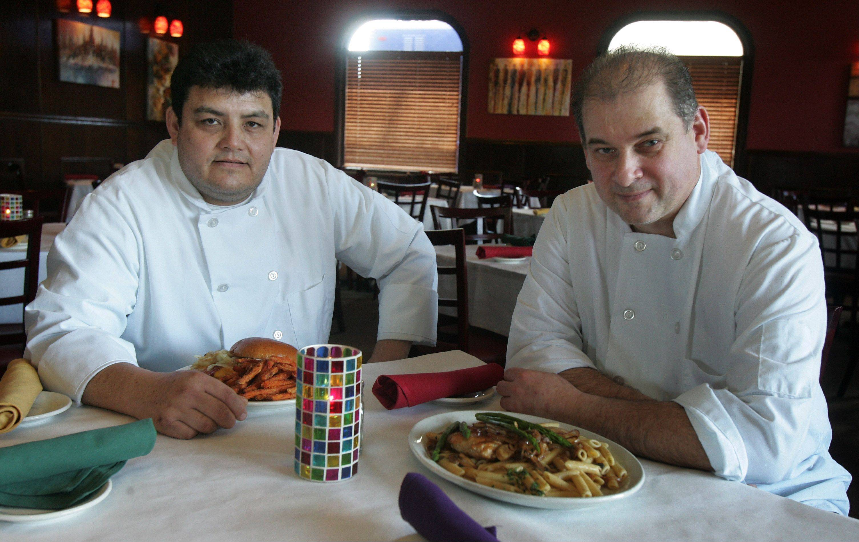 Executive chef John Warren, right, and sous chef Fernando Flores, man the stoves at Confetti's in Gurnee.