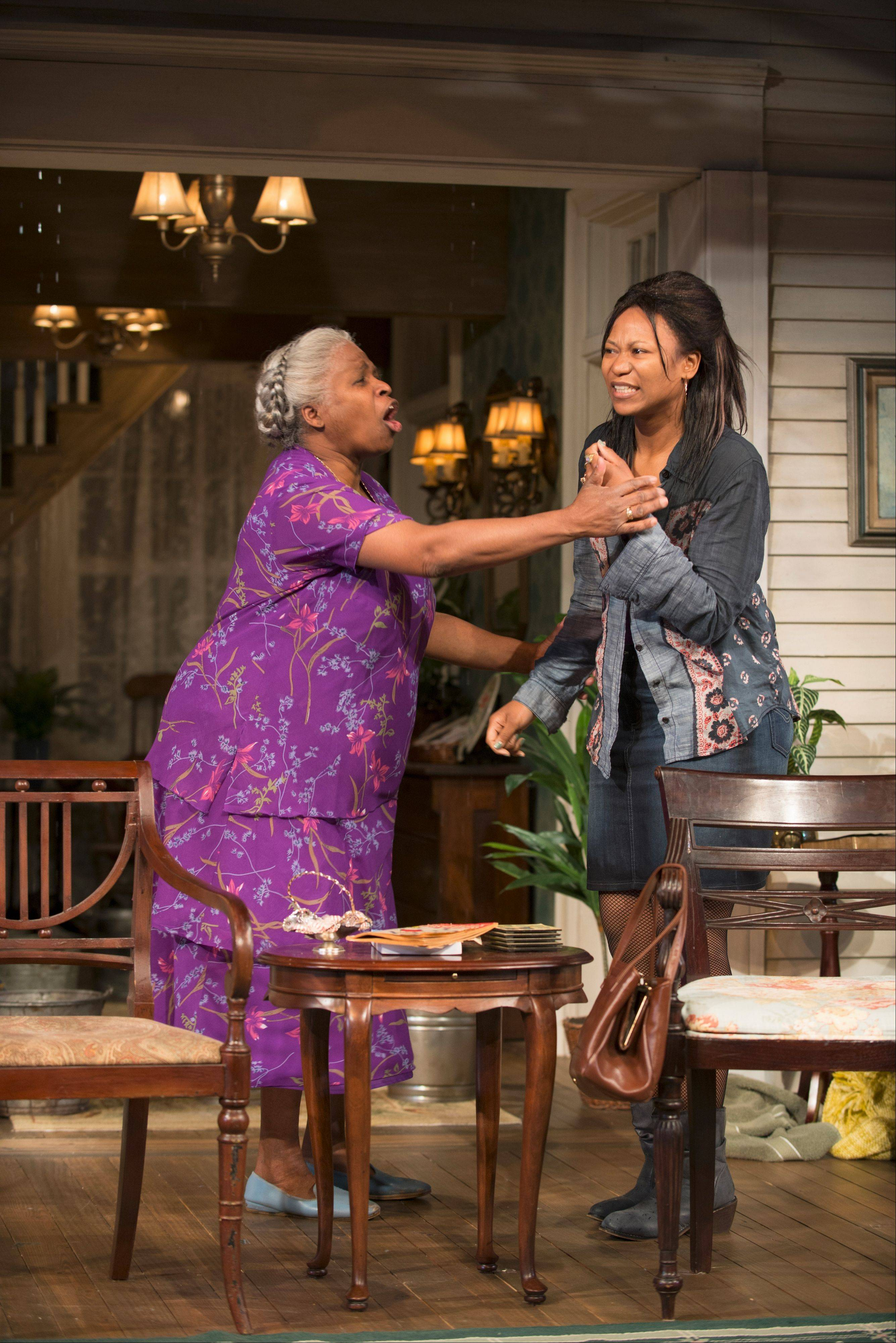 "Shelah (Cheryl Lynn Bruce) tries to calm Cookie (Alana Arenas) in Steppenwolf Theatre Company's production of ""Head of Passes,"" written by ensemble member Tarell Alvin McCraney."