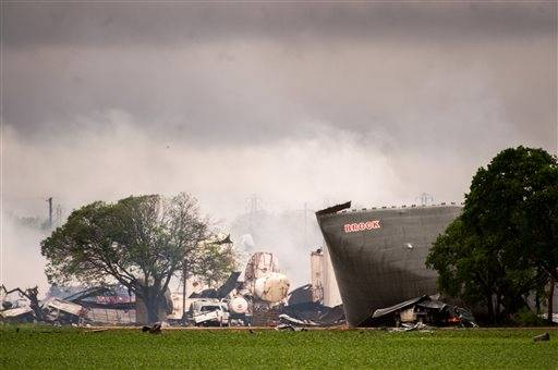 The remains of the the West Fertilizer Co. plant smolder in the rain on Thursday, April 18, 2013, in West, Texas. A massive explosion at the plant killed as many as 15 people and injured more than 160, officials said overnight.