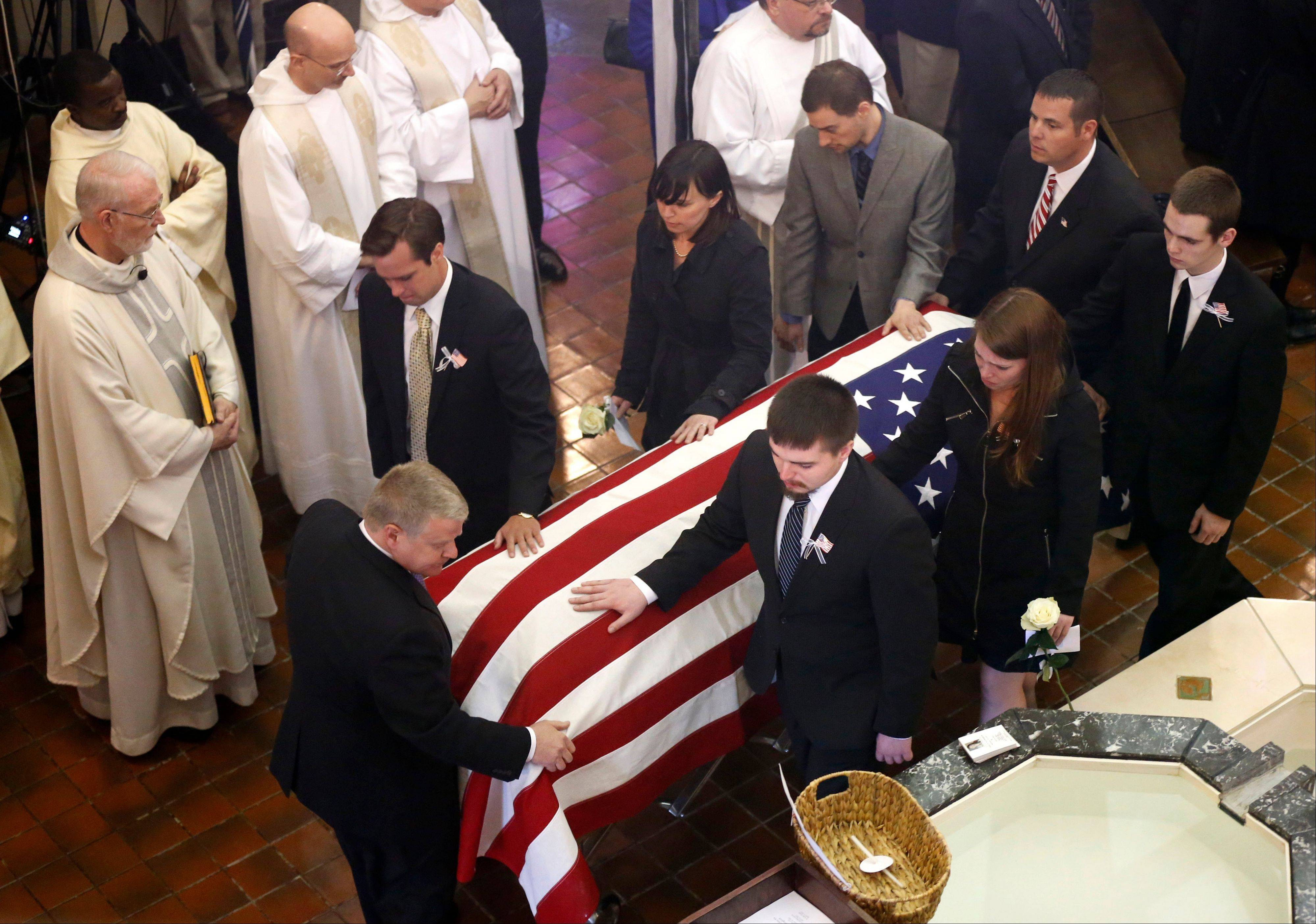 Pallbearers escort the casket of U.S. diplomat Anne Smedinghoff out of St. Luke Catholic Church in River Forest on Wednesday.