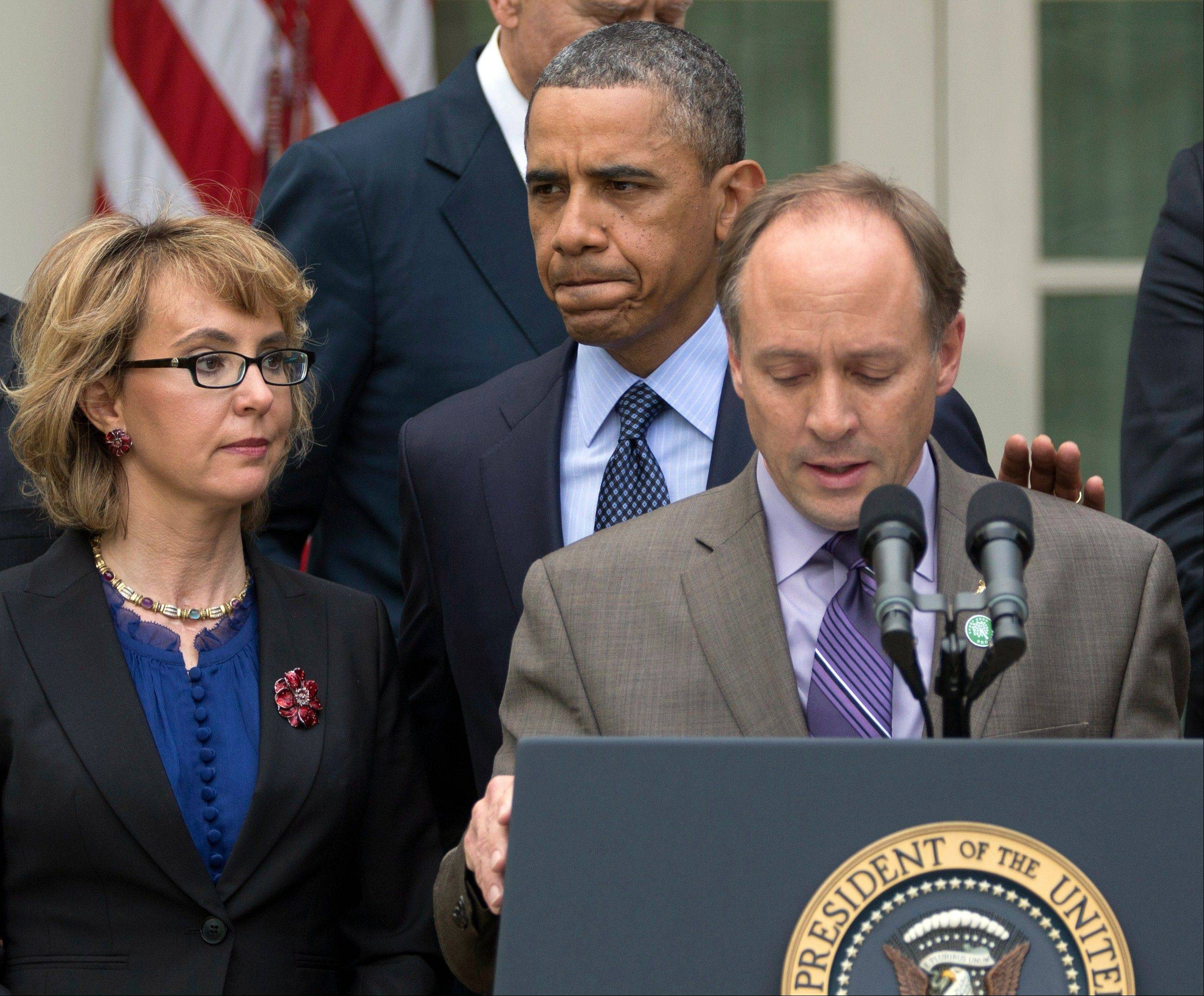 President Barack Obama arrives to participate in a news conference in the Rose Garden of the White House on Wednesday in Washington, about measures to reduce gun violence. With Obama is former Rep. Gabby Giffords, left, and Mark Barden, the father of Newtown shooting victim Daniel.