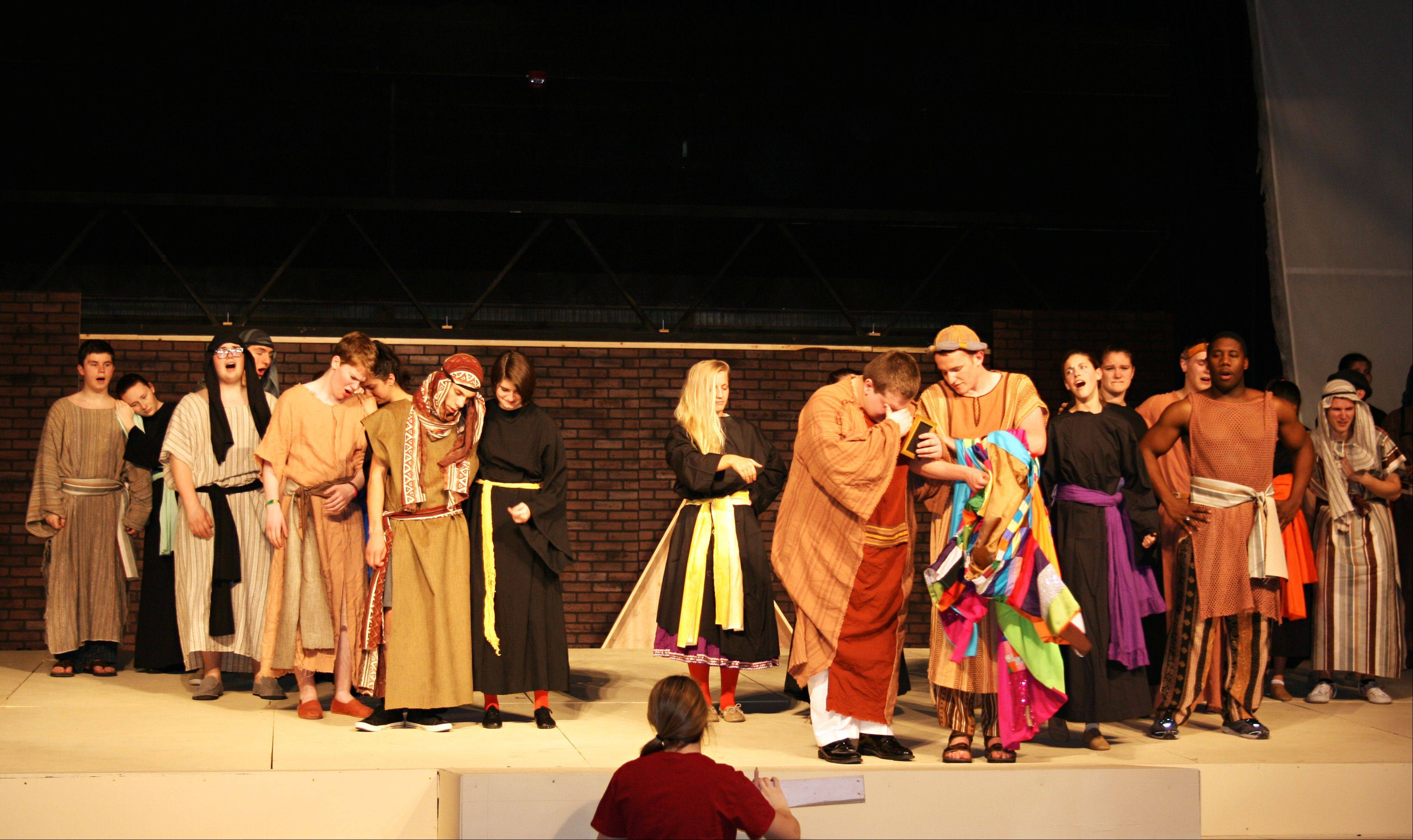 "Cast members rehearse ""Joseph and the Amazing Technicolor Dreamcoat"" at Marmion Academy in Aurora. The show opens Friday, April 19, and runs through Sunday, April 21."