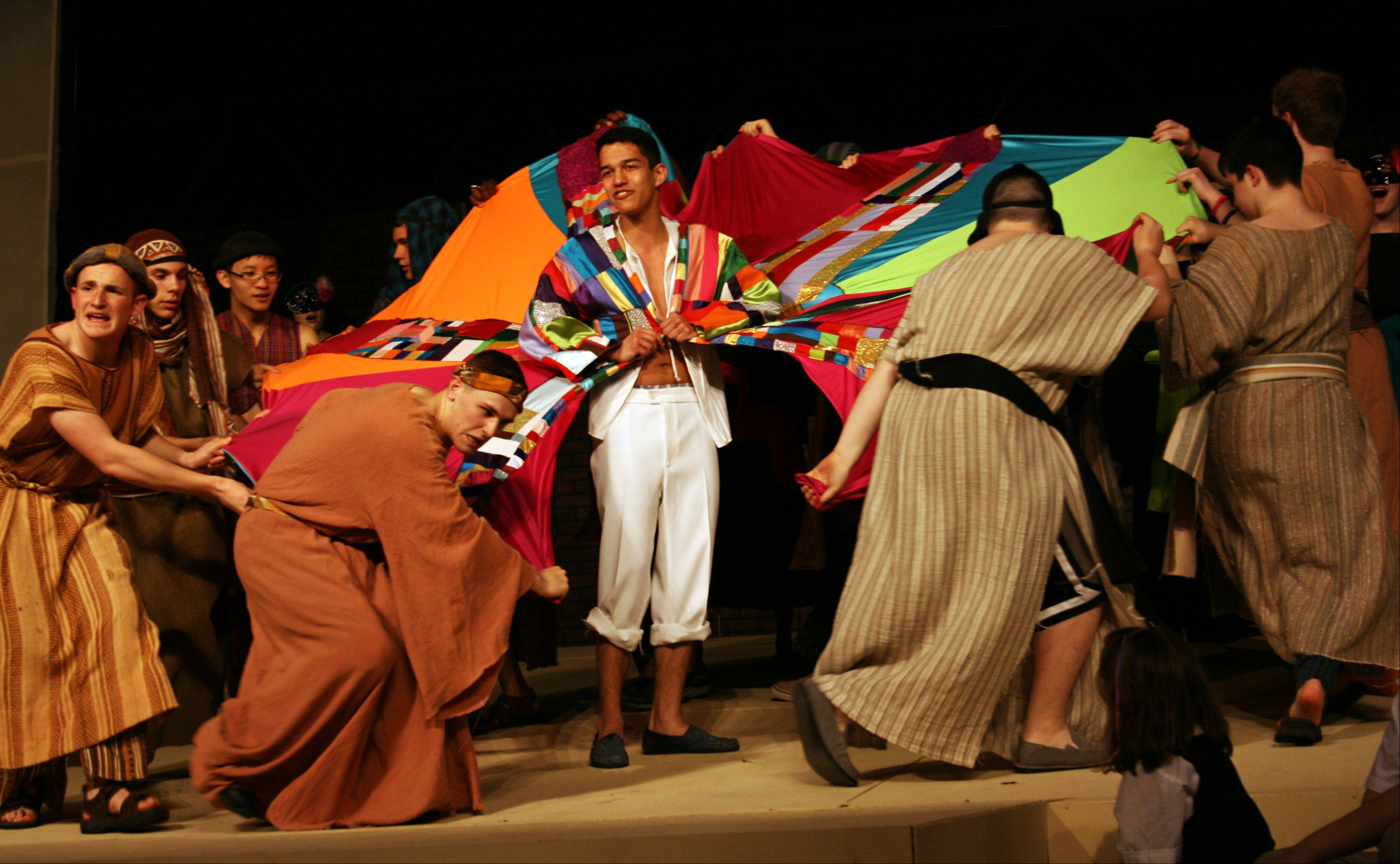 "Cast members rehearse Marmion Academy's production of ""Joseph and the Amazing Technicolor Dreamcoat."" New this year is a 2 p.m. Saturday matinee."