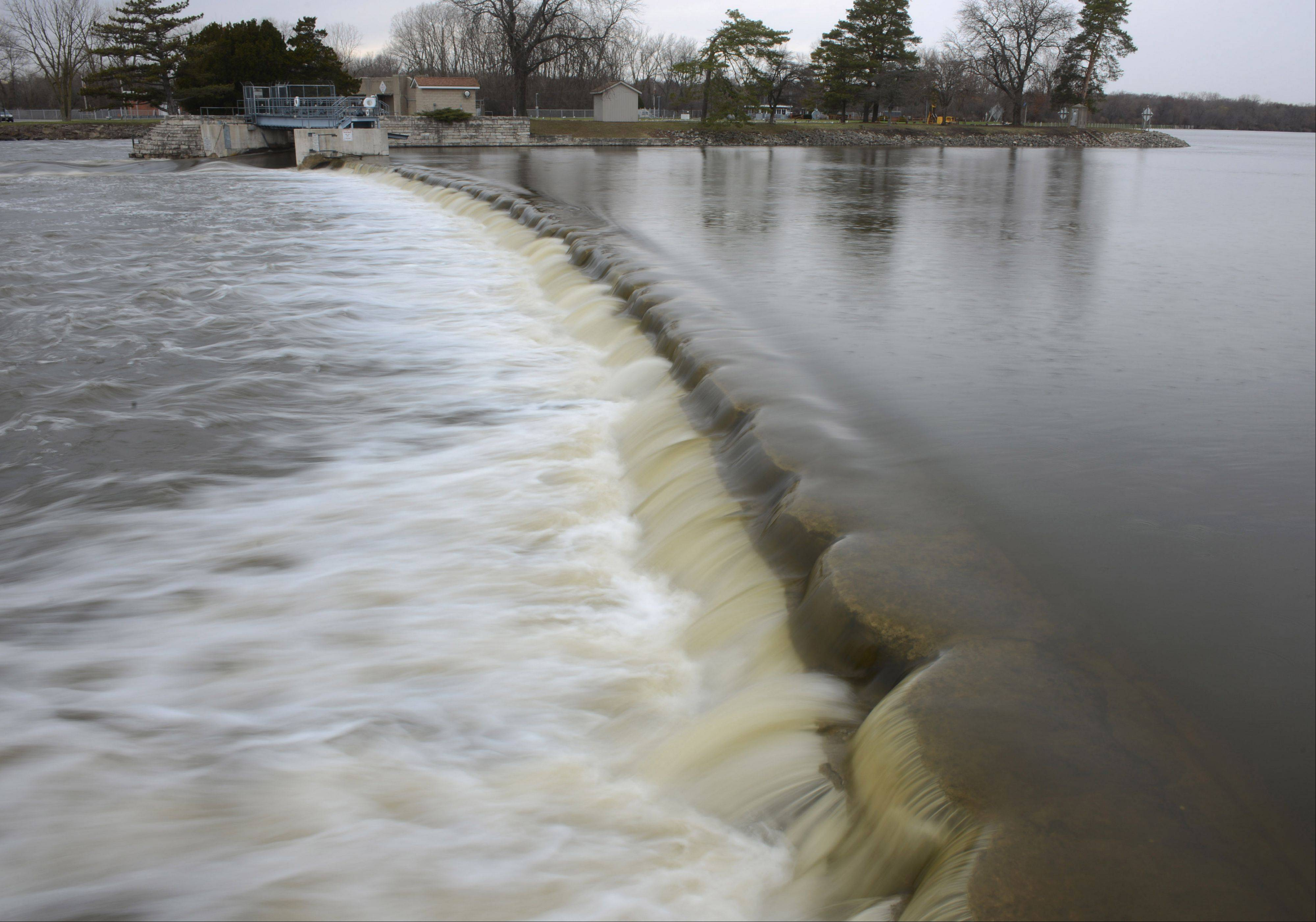 Water in the Fox River flows over the dam at the McHenry Dam State Park off River Road north of Island Lake on Wednesday.