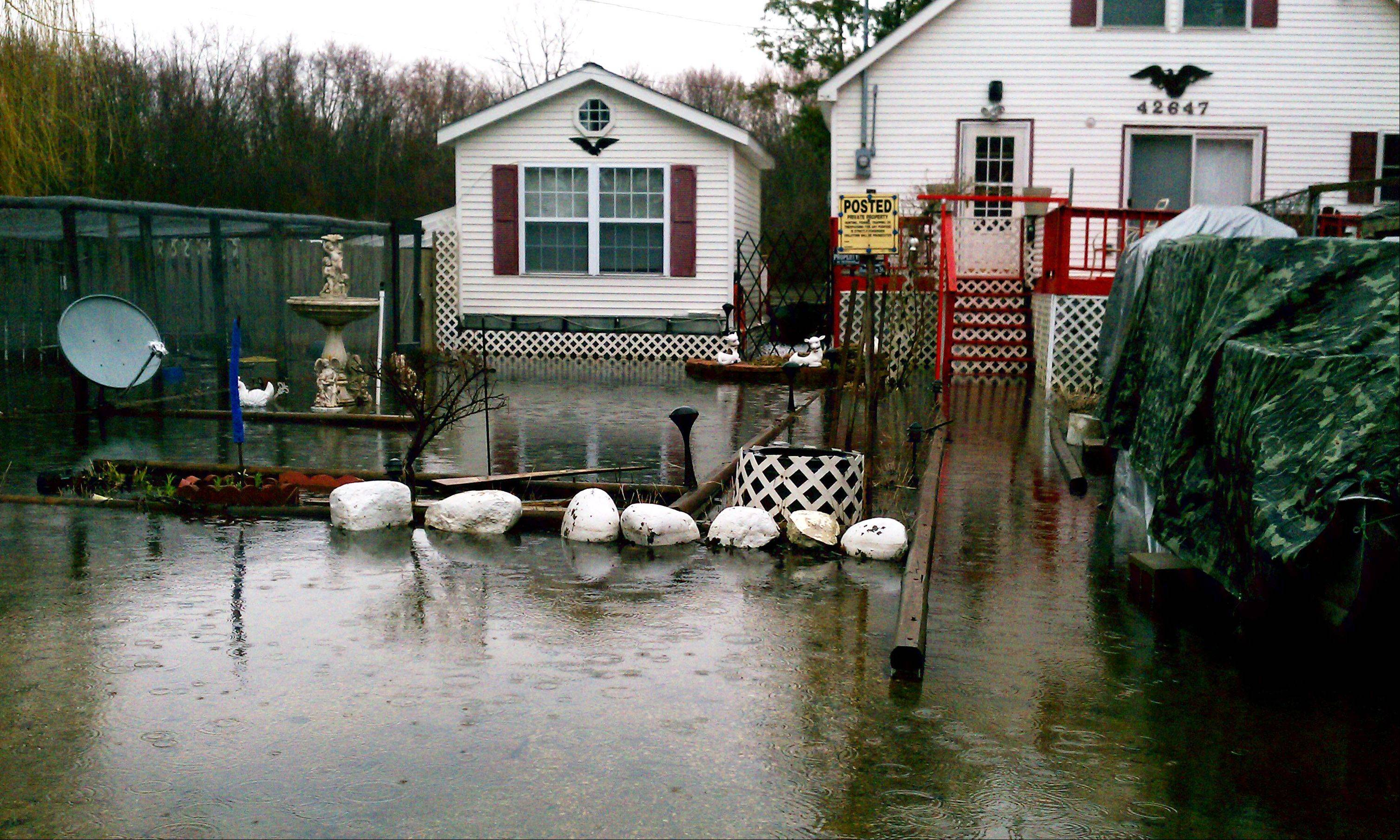 Flooding has begun on Lawson Drive in the Fox River Springs subdivision Wednesday in Antioch Township.