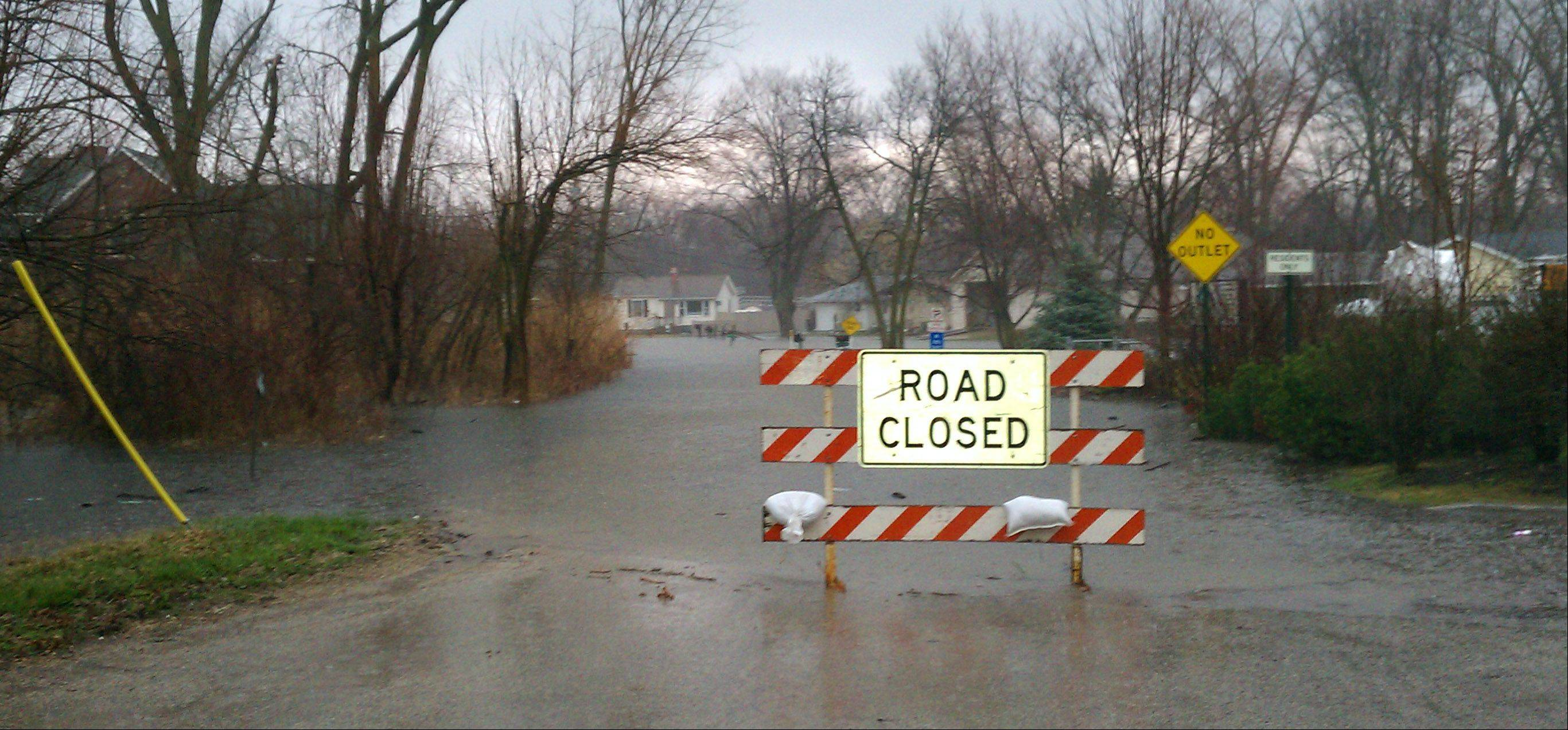 Flooding blocks roads in Kings Island subdivision in Fox Lake on Wednesday.