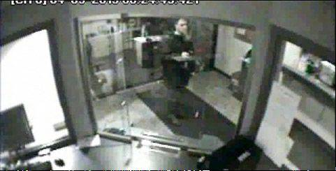 Howard R. Lazarus of Mundelein is seen in this picture from the police video holding a firearm inside the Vernon Hills Police Department on April 3. Police later said the weapon was a realistic-looking fake.