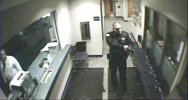 After shooting Howard R. Lazarus inside the Vernon Hills Police Station, this picture from the police video shows the police officer moving in on suspect on April 3.