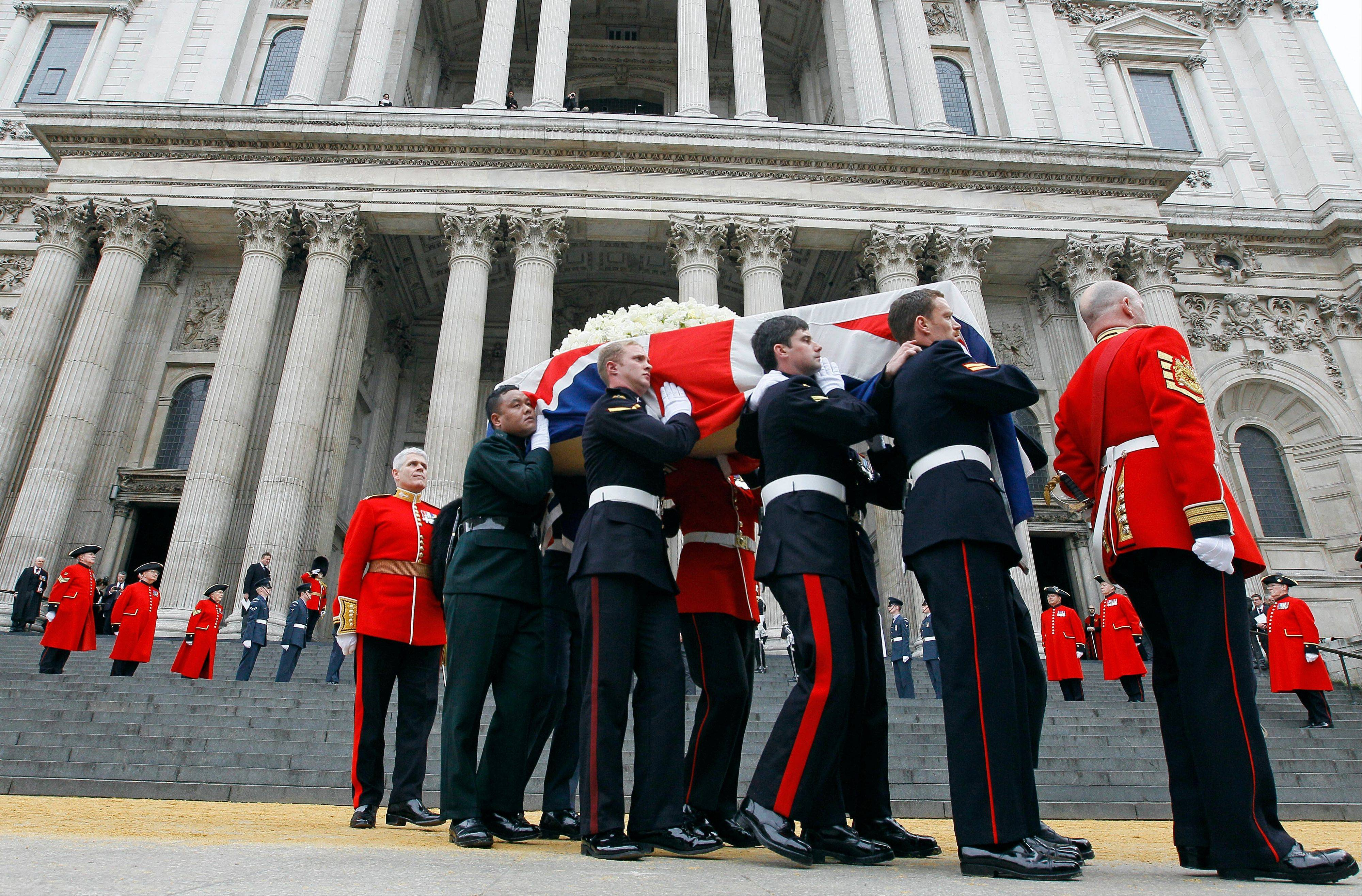 Former British Prime Minister Margaret Thatcher's coffin is carried by pallbearers out from St Paul's Cathedral, following the ceremonial funeral service in London, Wednesday, April 17, 2013. Thatcher, who died, at the age of 87 on April 8, has been accorded a ceremonial funeral with military honors, one step down from a state funeral. Thatcher was elected Prime Minister on May 4, 1979 and she resigned on Nov. 28, 1990, after eleven years in office.