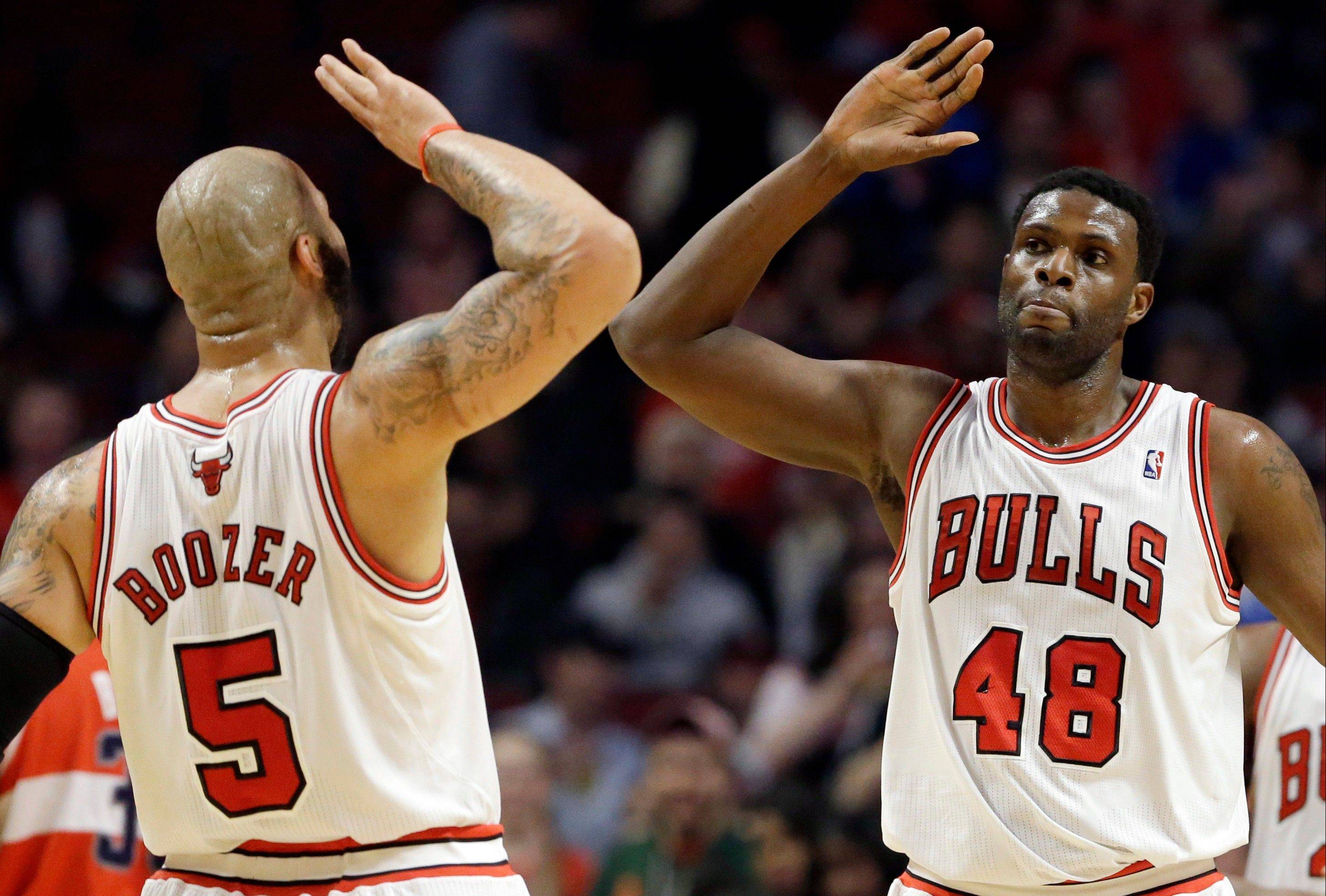 The Bulls' Nazr Mohammed, right, and Carlos Boozer celebrate during the regular-season finale Wednesday at the United Center. Mohammed scored a season-high 17 points in just 22 minutes of action.